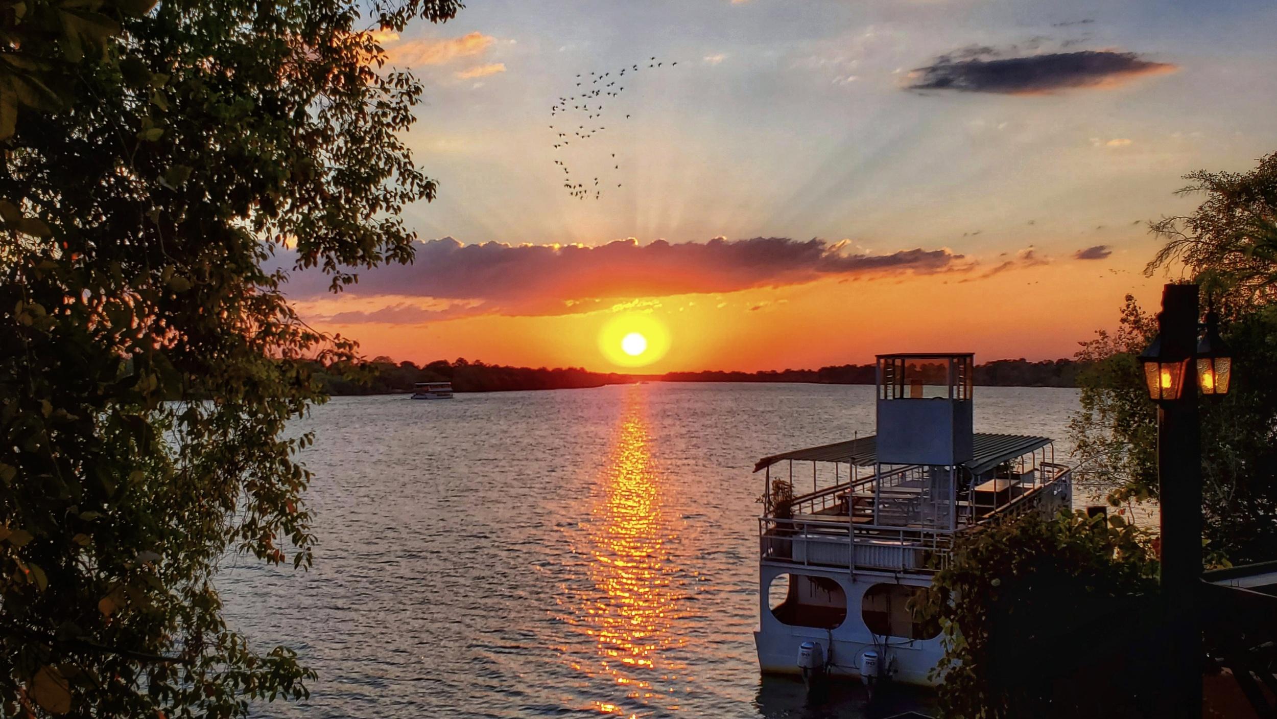 Sunset on the zambezi river in Livingstone, Zambia