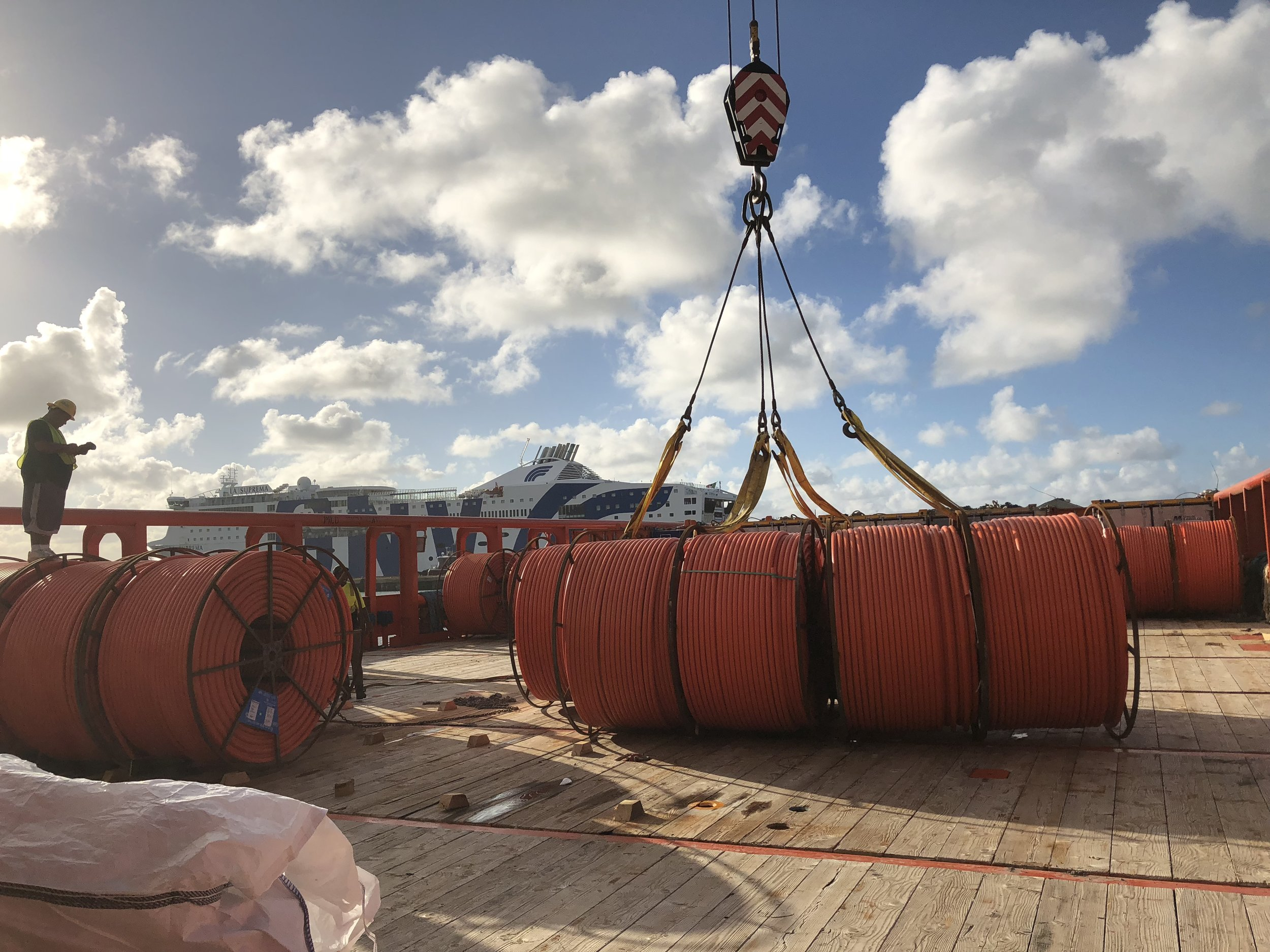 The large crane makes short work of the cargo easily lifting several reels at a time.