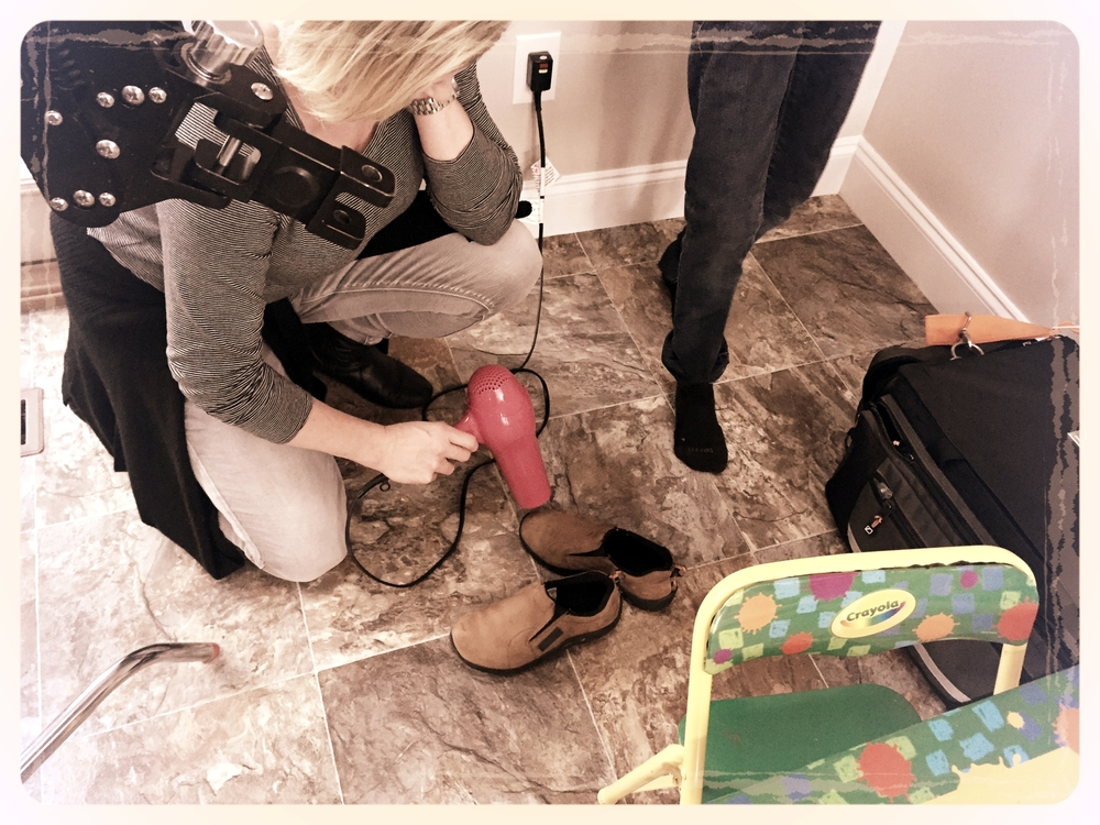 6 STRONG MEDIA Makeup Artist (Angela Jordan) quickly dries our actor's shoes so we can get a few more takes of the dog food scene.