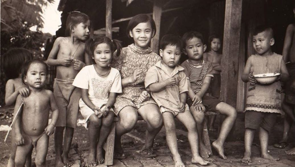 The Sudhinaraset Family and Neighborhood Kids in Thailand 1960.