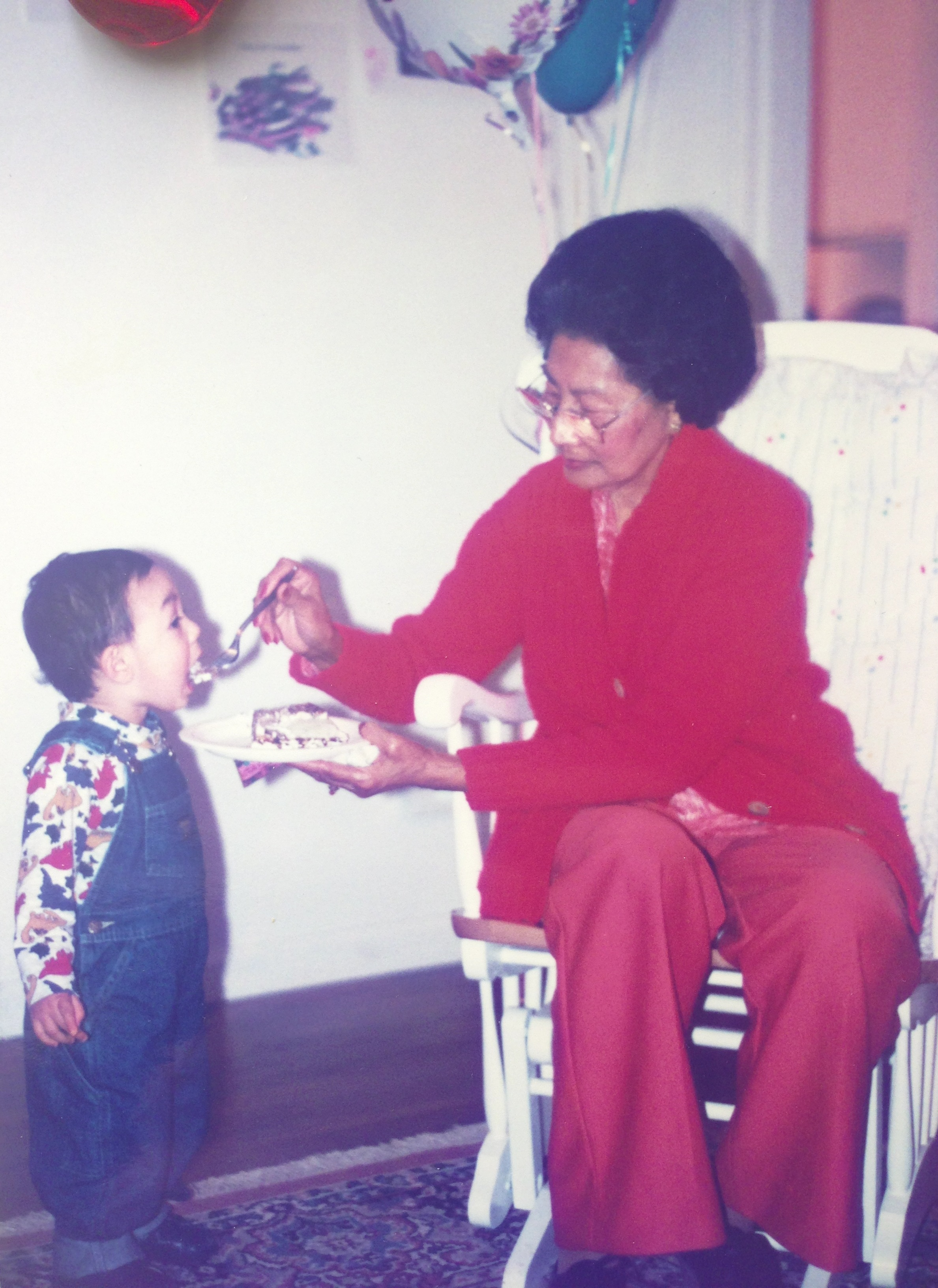 Me as a toddler, being fed by my maternal grandmother