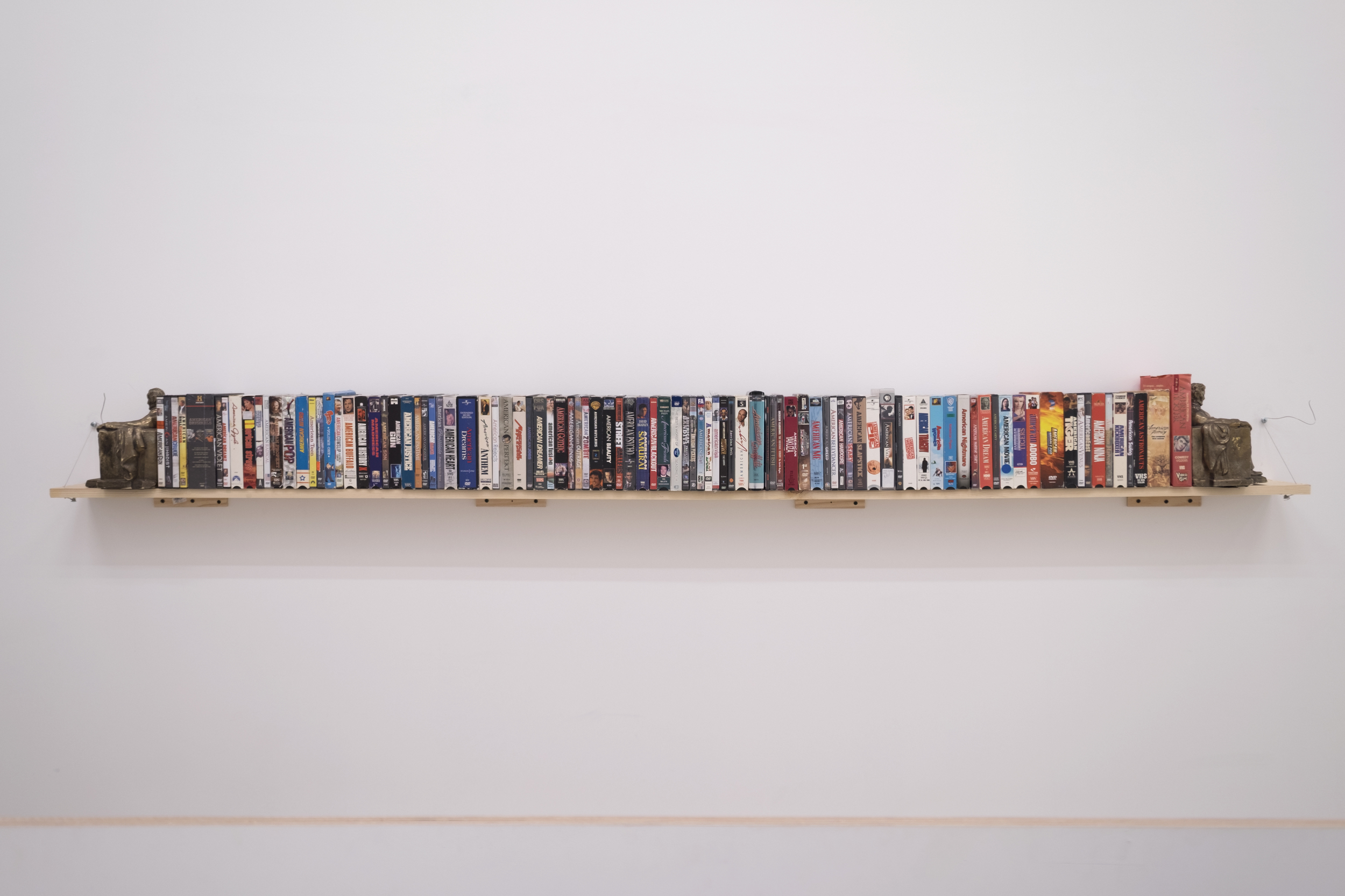 Eric Yahnker   American Piece  2010-2016 94 DVD/VHS media, 2 bookends 9 x 100 x 6 in.