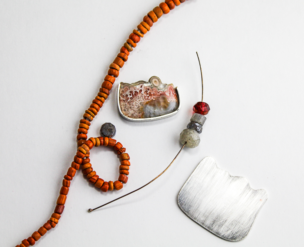 One of my Gary Wilson stones;crazy lace agate necklace in process. I think my 1,000 year old Tibetan glass trade wind beads, labradorite and 24k infused Czech glass bead will play well together.