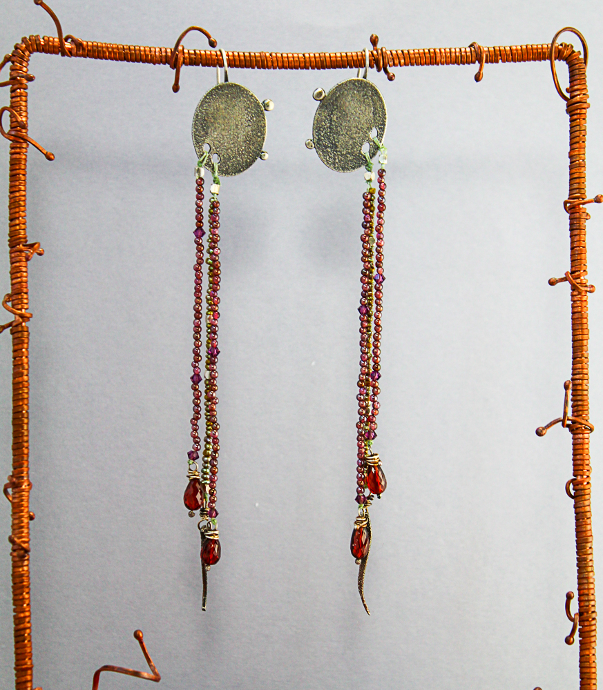 Earrings inspired by my last visit to the Ancient Etruscan exhibit at the museum. I've paired my textured, oceanic silver with long strands of garnet and pearl beads ending in garnet drops. Long earrings work so well with long hair. These just dust the shoulder with a bit of sparkle.