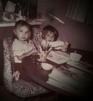 The three year old Deanna colouring with her childhood friend.