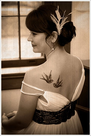 woman with back tattoos