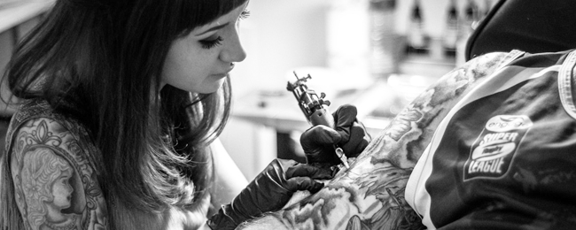 woman tattoo artist working