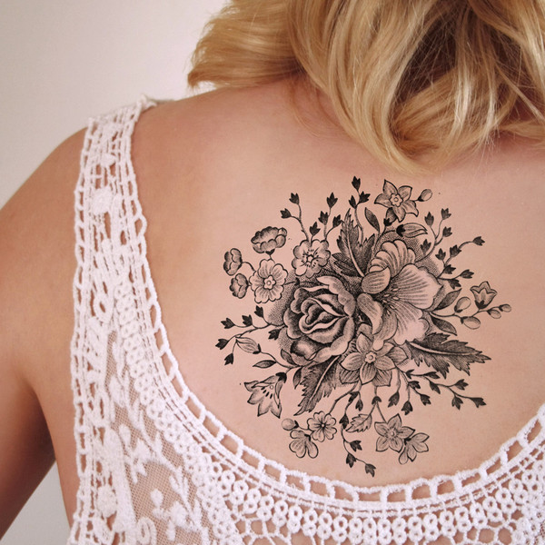 flower tattoo upper back