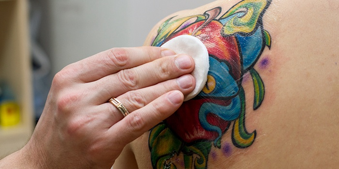 applying ointment on a tattoo