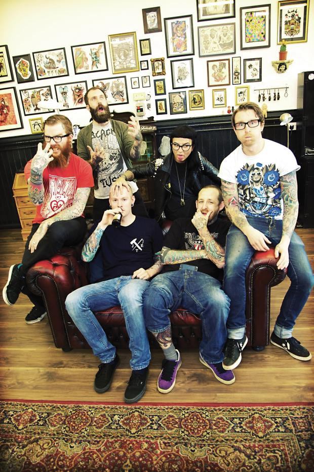 young people in a tattoo shop