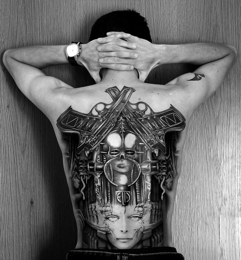 man with large back tattoo