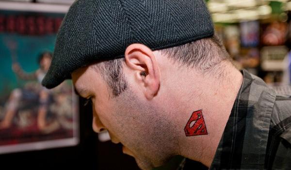 man with superman tattoo