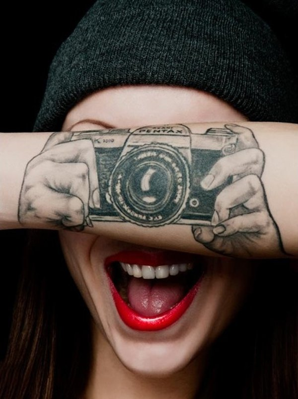 happy woman with arm tattoo
