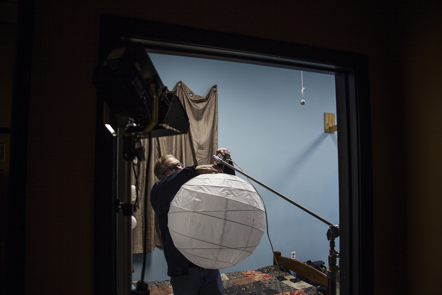 Brad Hoover preparing lighting for the first scene of the day.