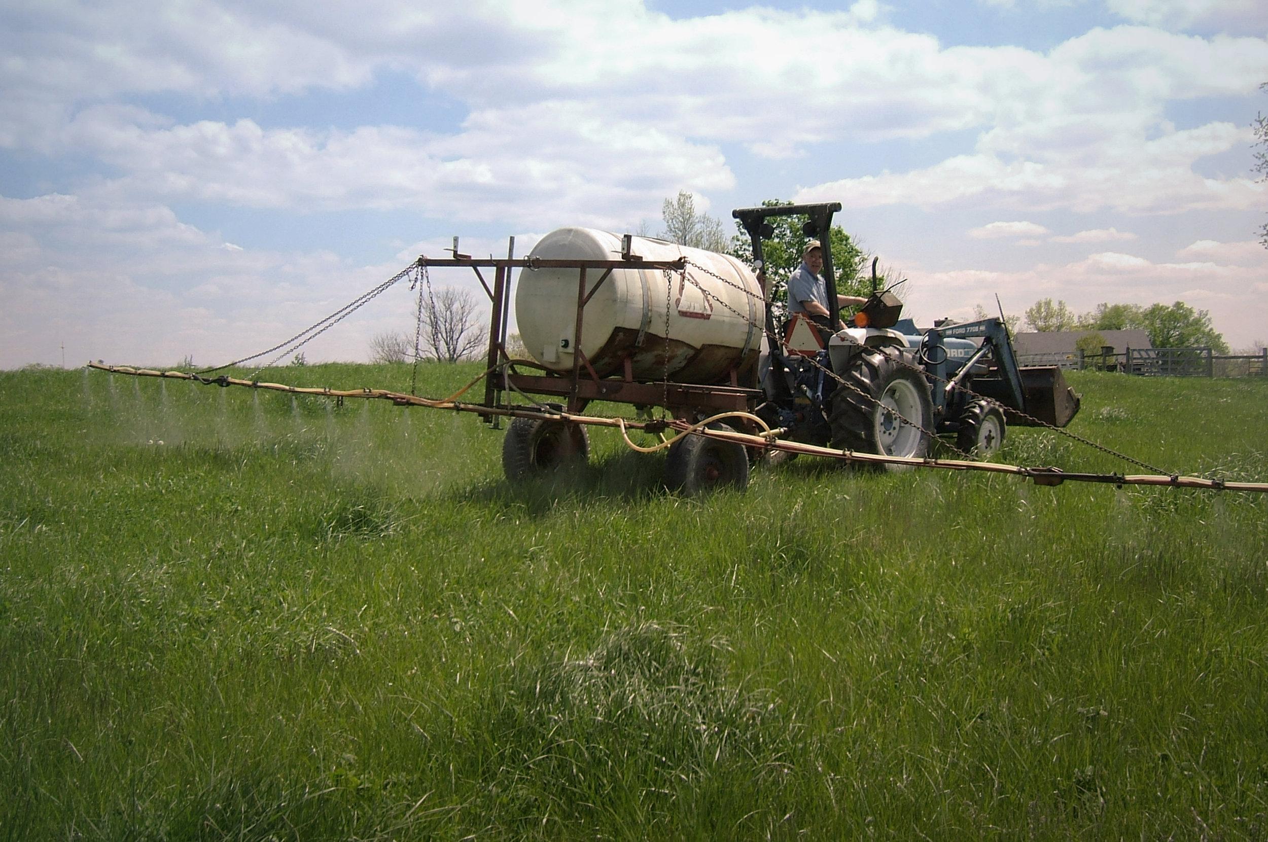 Spraying organic liquid fertilizers on pastures