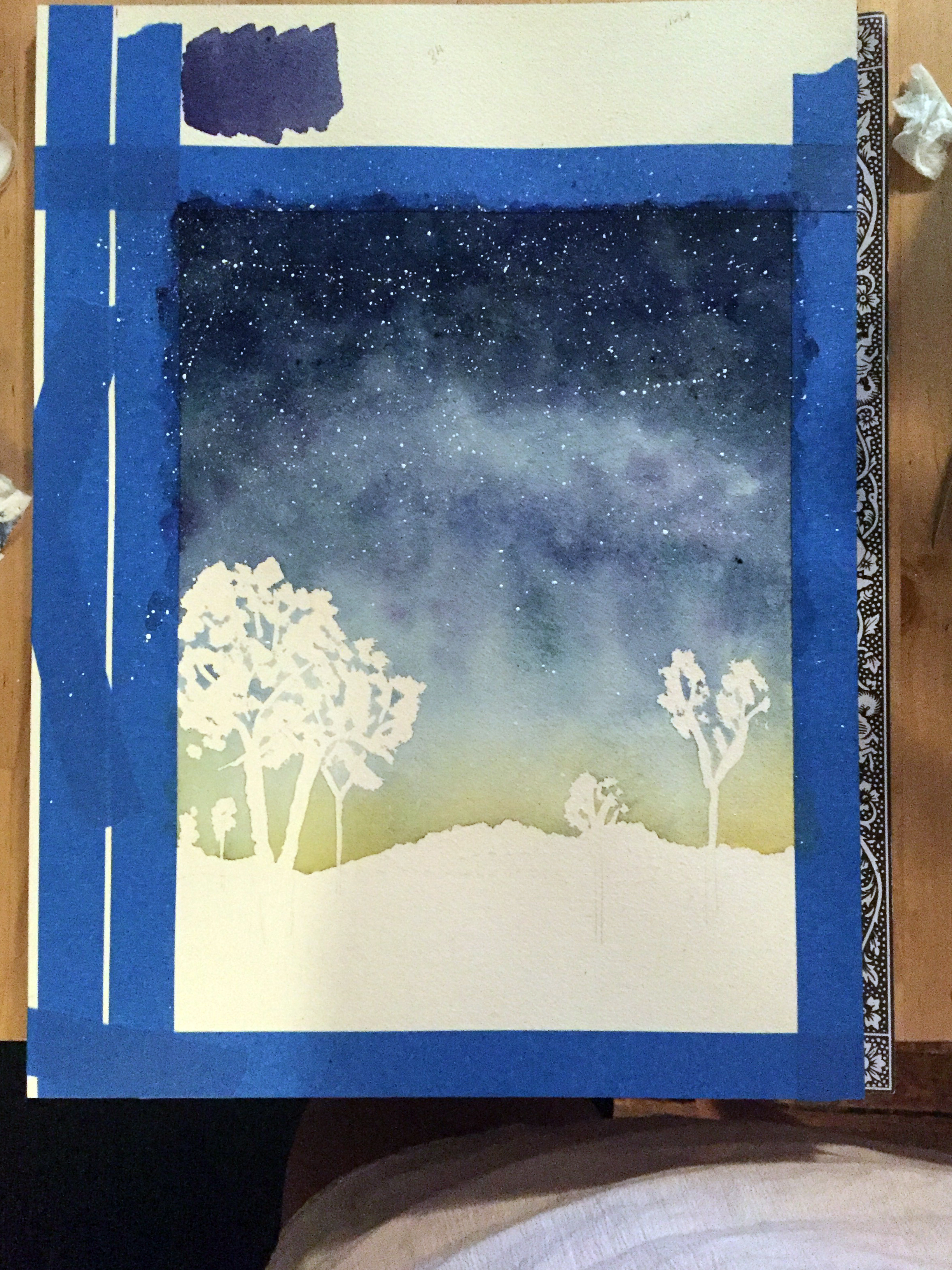 Step 2: Once the sky is complete, gently splatter white paint to represent the stars. Once this is dry, carefully remove the masking fluid.