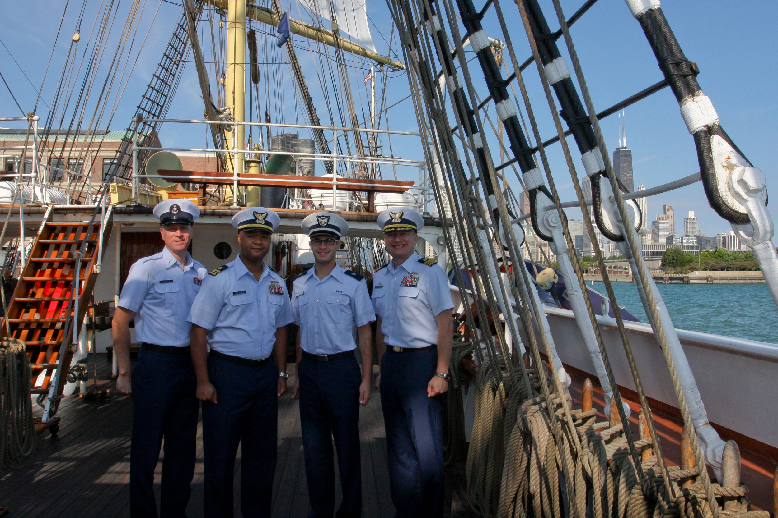 Roth poses with Cmdr. Jason Neubauer,commanding officer of Coast Guard Marine Safety Unit Chicago; Lt. Cmdr. Stacy Miller, executive officer; and Chief Petty Officer Alan Haraf on the tall ship Sorlandet at Navy Pier in Chicago, Aug. 8, 2013. Roth was a Coast Guard Ninth District public affairs intern with Haraf at MSU Chicago for eight weeks. U.S. Coast Guard photo.