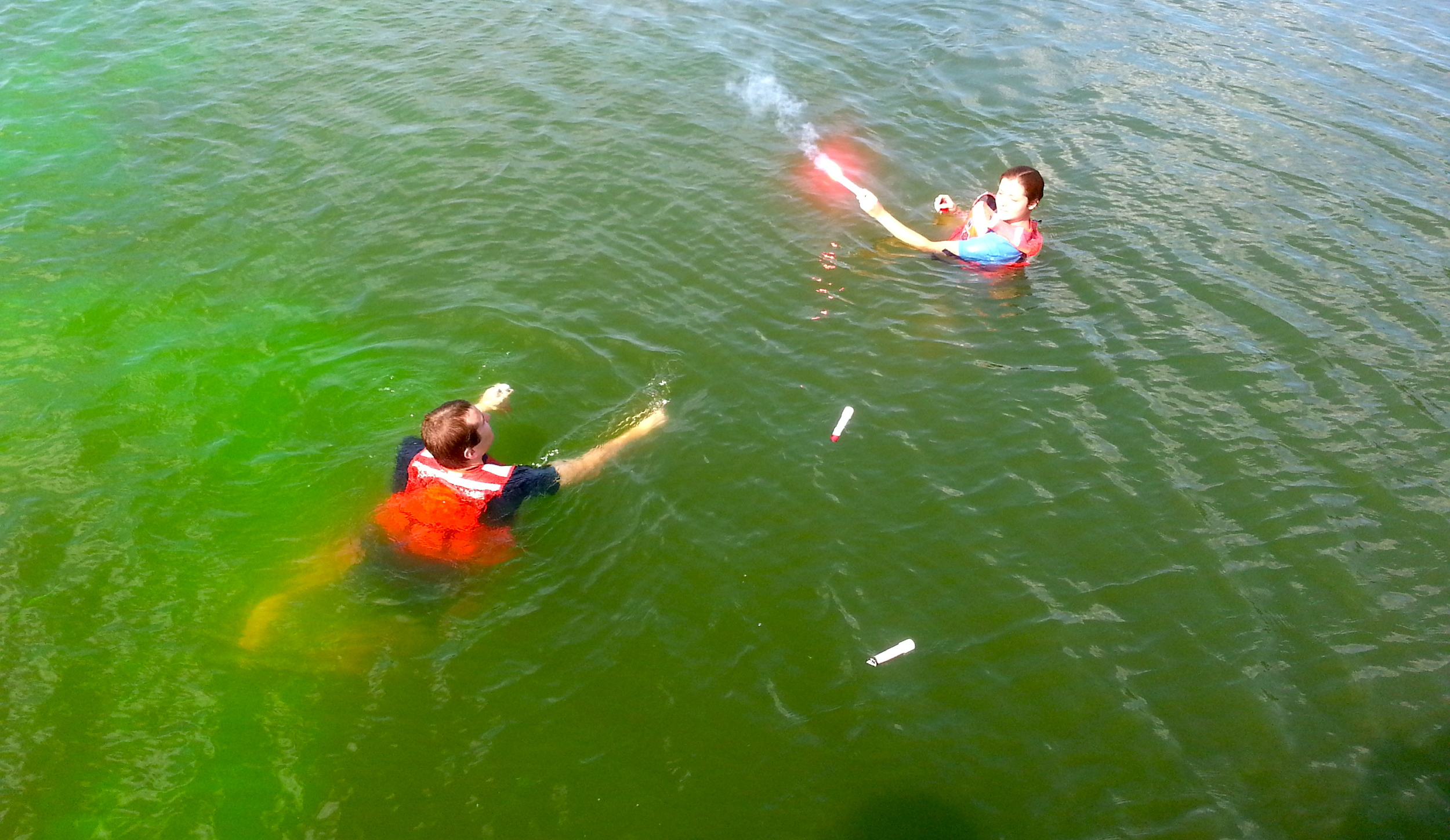 Wingler, on right, participates in a flare and dye marker exercise at Coast Guard Station Milford Haven, Va. U.S. Coast Guard photo by auxiliarist Stephanie Hutton.