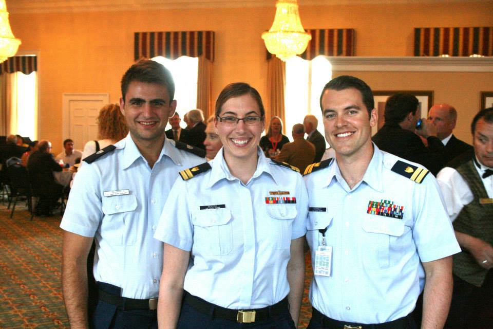 Silliman poses with Coast Guard officers at the retirement of Mr. Robert Pond, a senior technical advisor to CG-MER. U.S. Coast Guard photo.