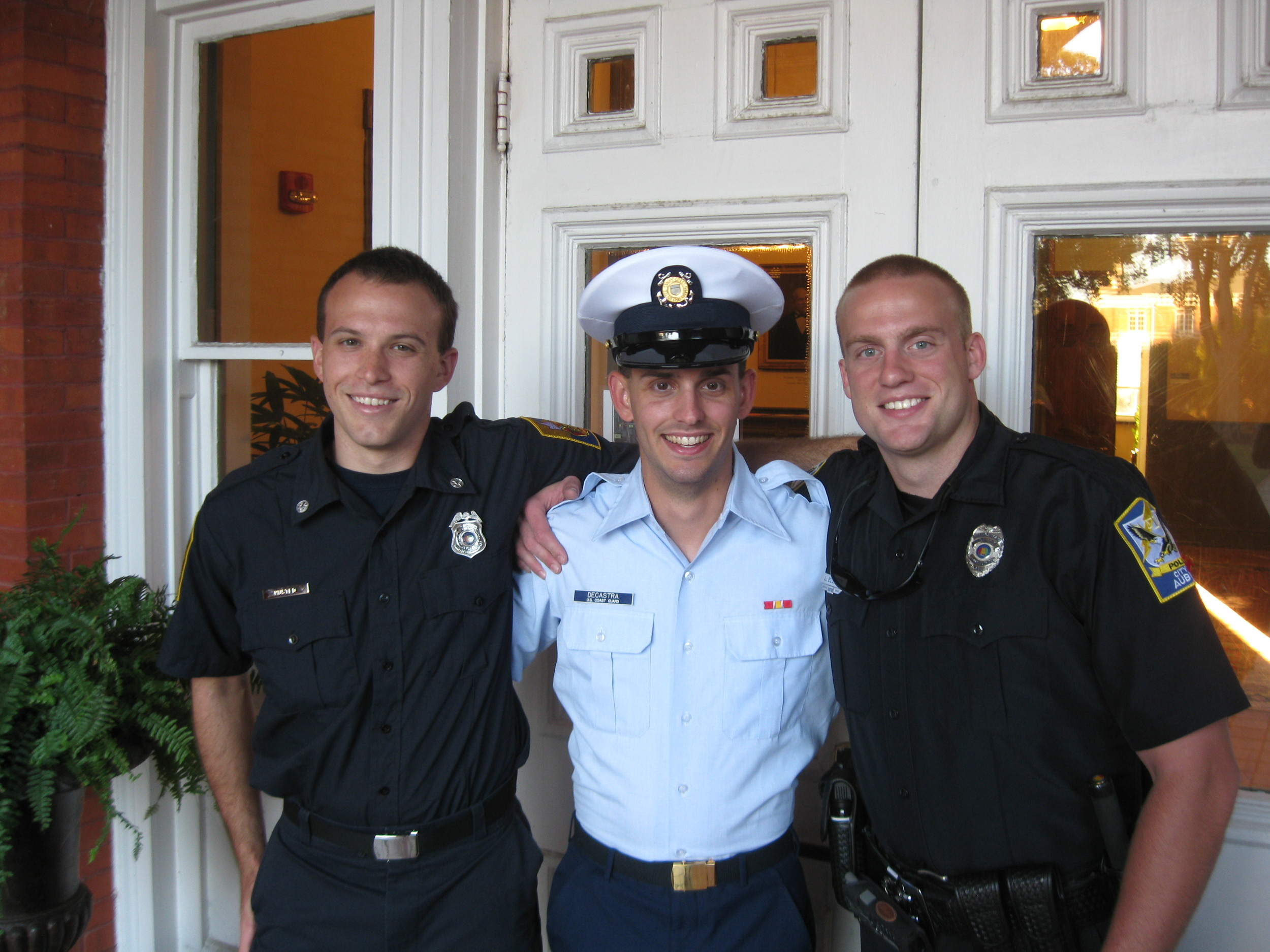 DeCastra, after graduating from TRACEN Cape May, gathers with Unit Auburn shipmates Andrew Husted (left) and Landon Elliot (right.) Mr. Husted currently works for the Auburn Fire Department and Mr. Elliot for the Auburn Police Department. Courtesy photo.