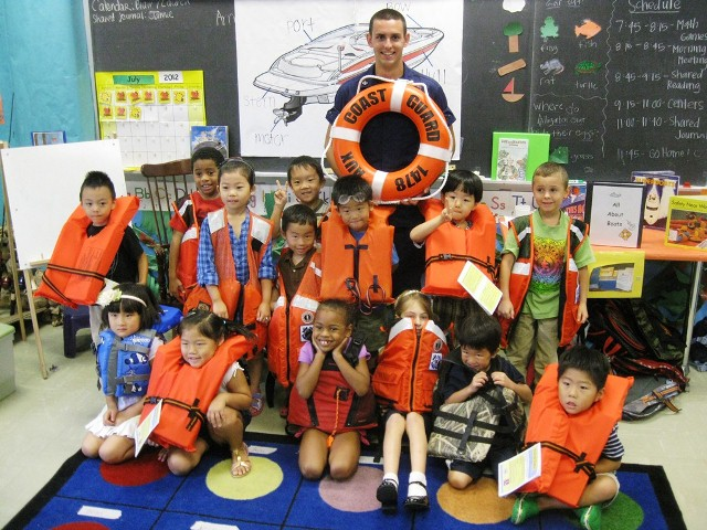 During his time at AUP Unit Auburn, DeCastra teaches young students the importance of always wearing a life jacket. Children's life jackets are approved for specific weight categories to provide optimal buoyancy and comfort to children of all ages. U.S. Coast Guard photo courtesy Flotilla 8-12, Auburn, Ala.