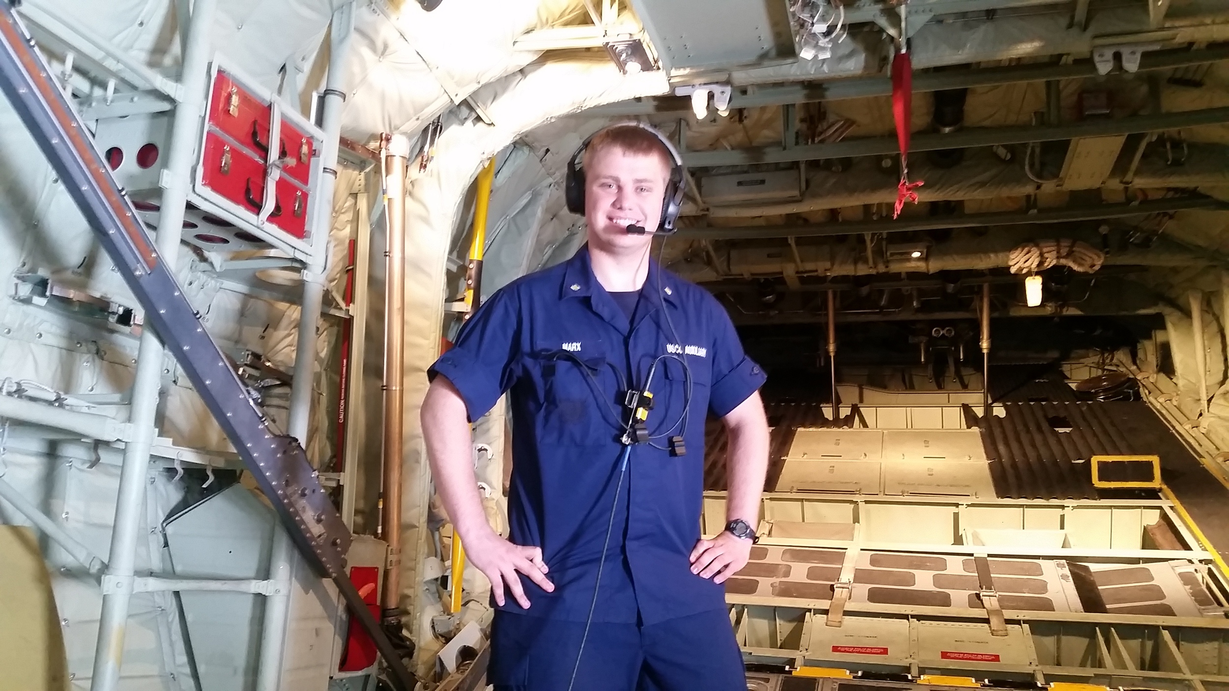 Jacob Marx stands in the rear cargo door of a HC-130J Hercules