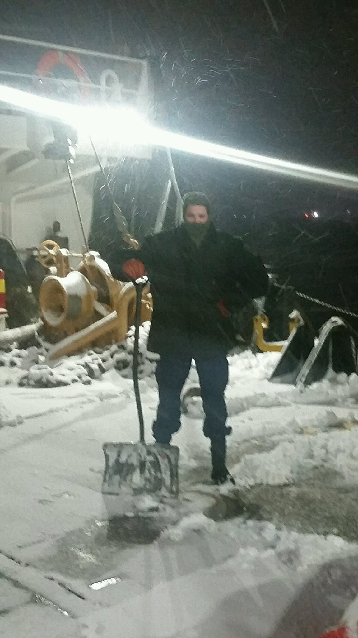 Auxiliarist Howard shoveling snow off the buoy deck.