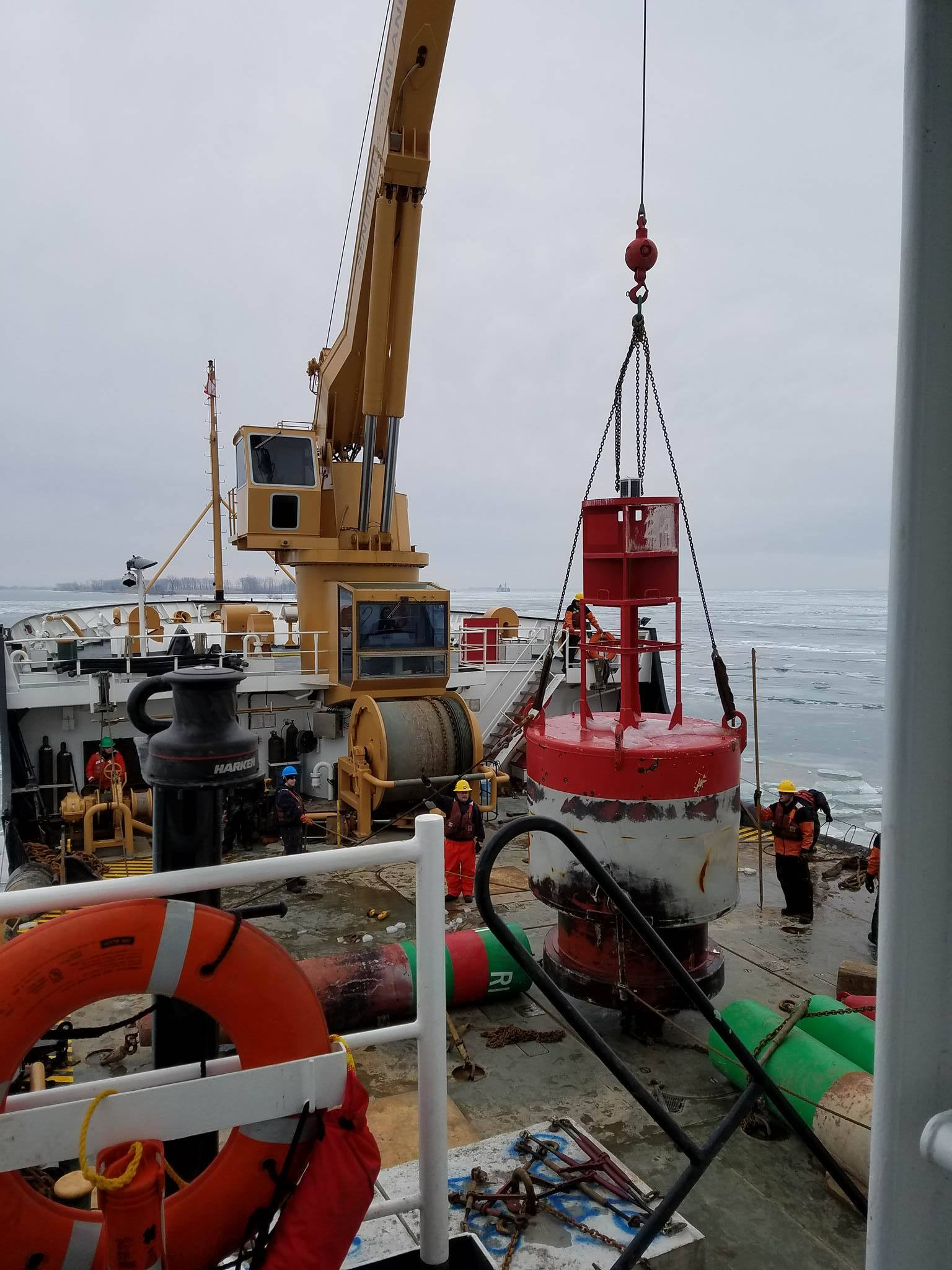 Deck crew brings in the last buoy of the season.