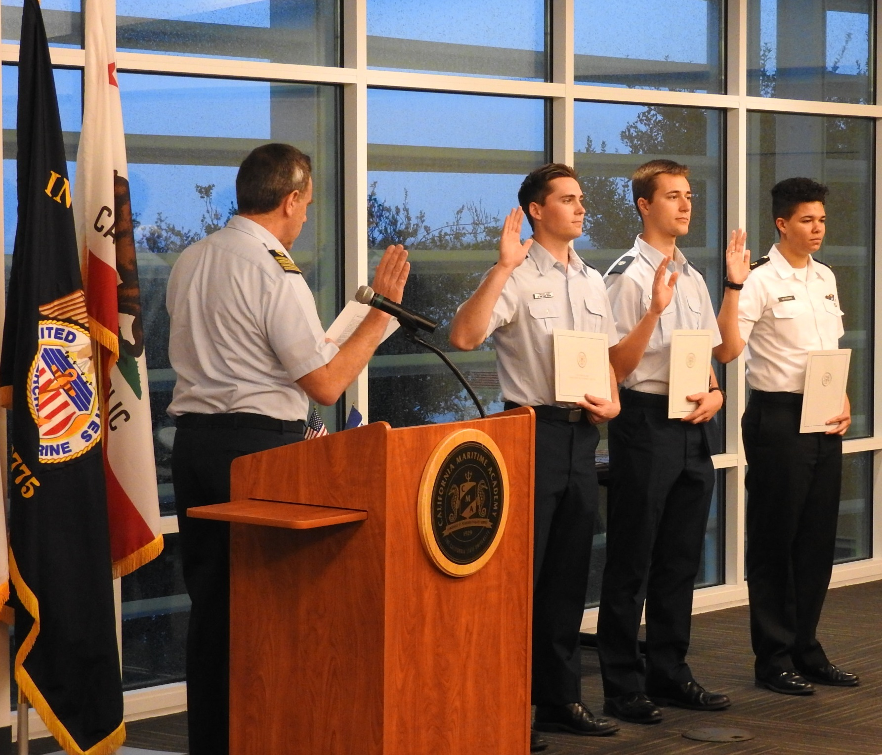 Captain William Drelling administering the Appointed Leaders Pledge for the new unit leadership (From left to right: Tyan Twisselman [Unit Leader], Austin Wittmann [Deputy Unit Leader], and Amelia Herrman [Operations Unit Leader])