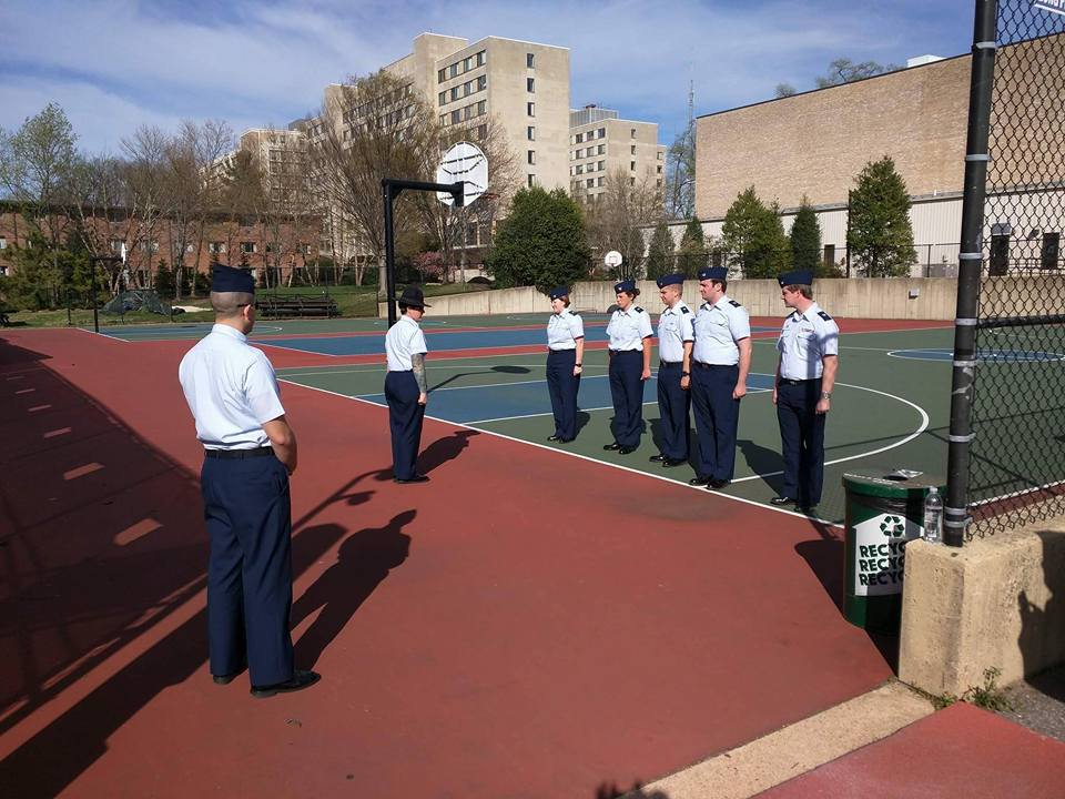 Members of the United States Coast Guard Auxiliary University Program receive drill from Company Commander MKC Reid at American University