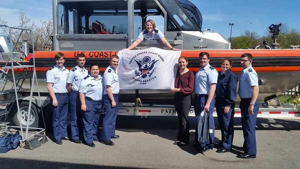 Members of the Auxiliary University Program in front of a 29' Response Boat Small at Station Washington.