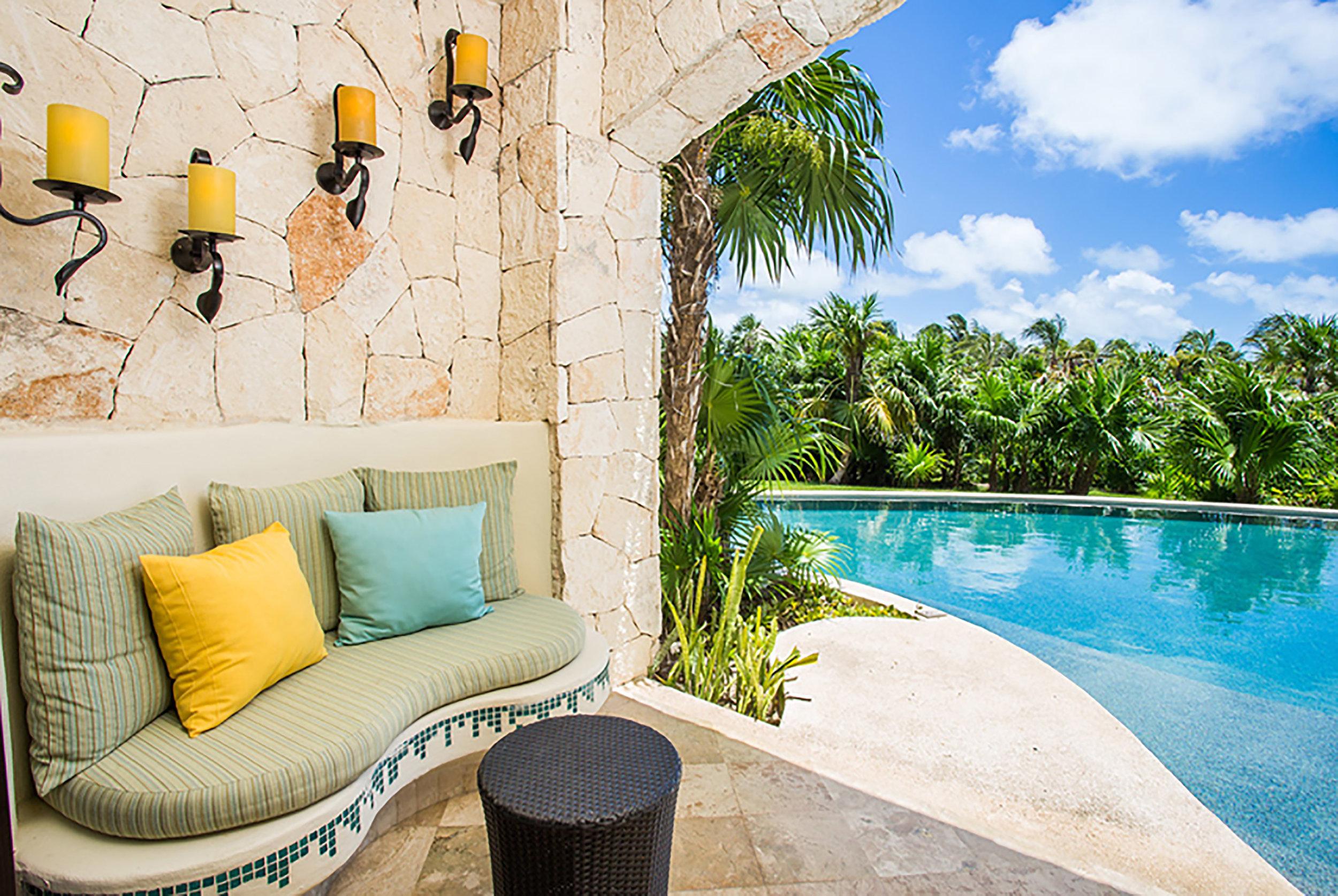 Secrets-Maroma_Junior-Suite-Swim-Out-Tropical-View-terrace.jpg