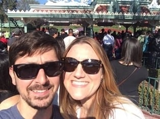 Sara & her husband enjoying a day at Disneyland during the holidays in sunny California