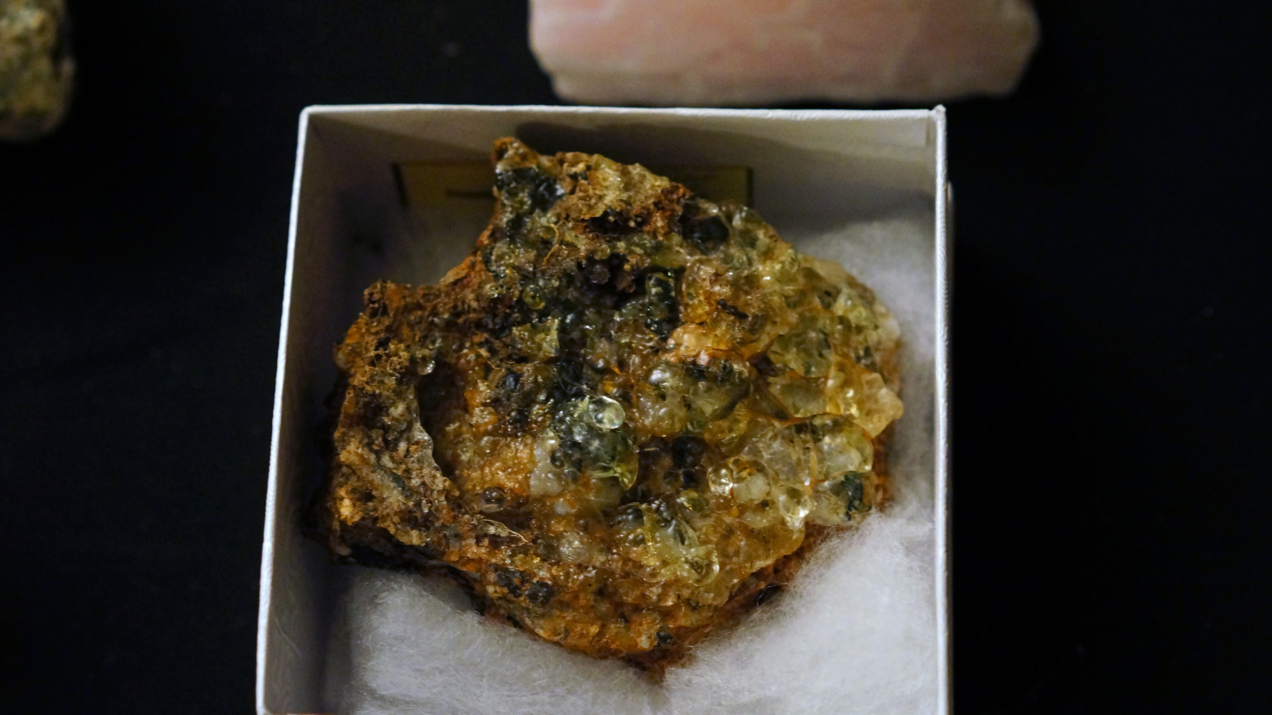 A piece of that gemmy daylight fluorescing hyalite from Zacatecas, Mexico. I would love some but it's way too expensive for my blood!