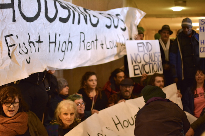 Protestors blocked the entrance to the Governor Kate Brown's office during demonstration at the state capitol Thursday. The legislators voted hours later on a historic hike in the state's minimum wage.