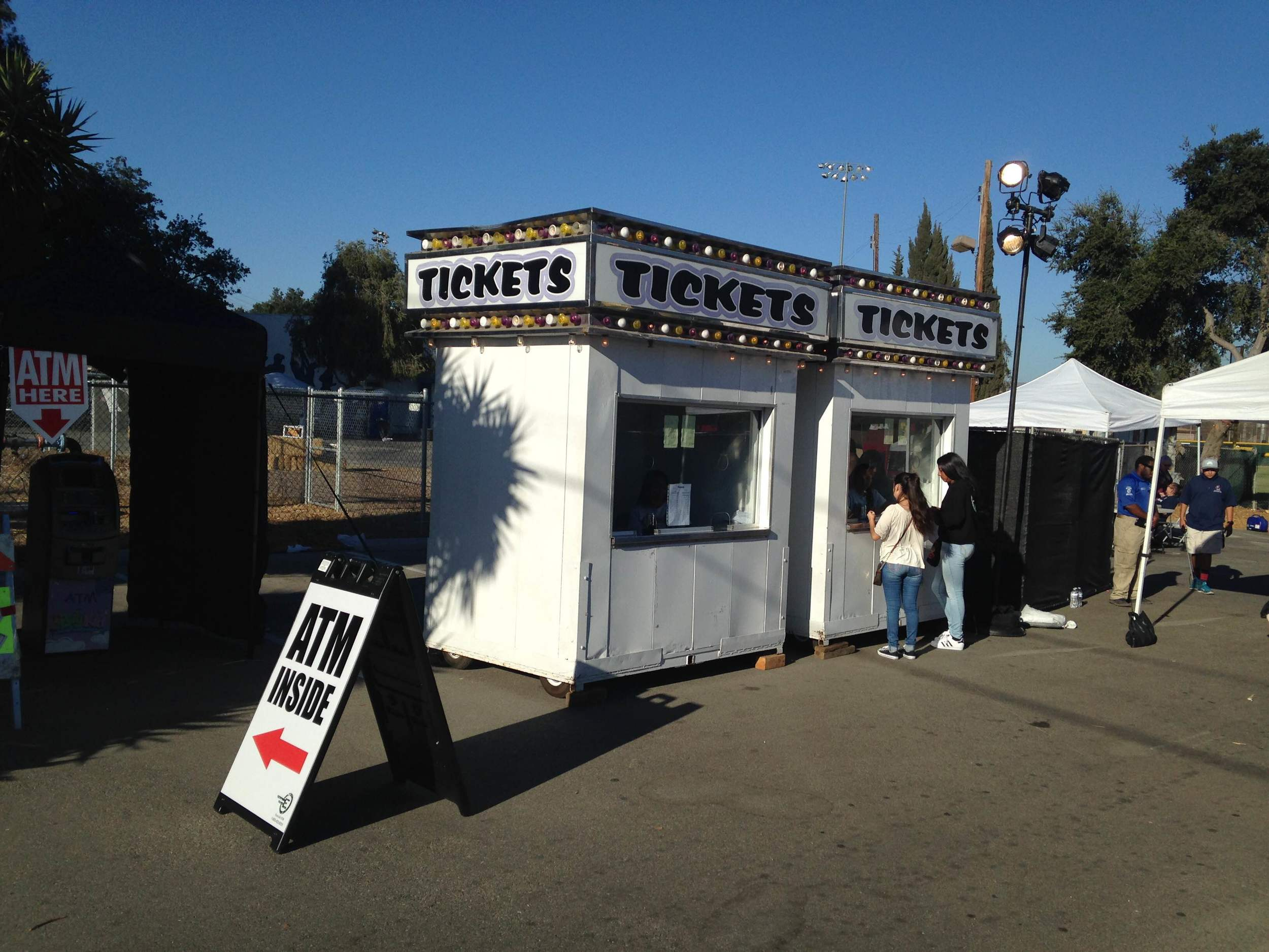 2016 45th Annual Citrus Festival, Ventura California.  ATM rental machine set up at the entrance and ticket booth.