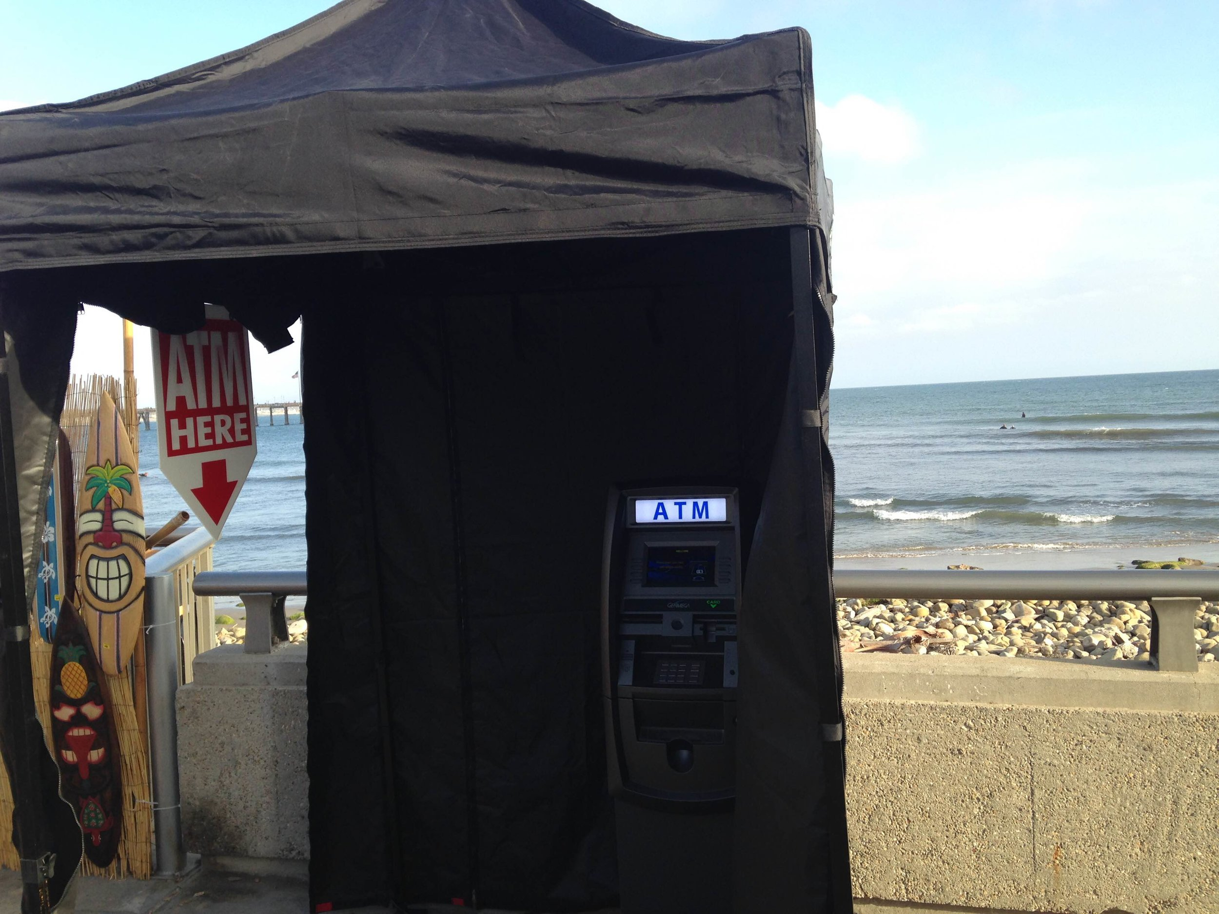 2016 Aloha Festival in Ventura California:  Mobile ATM placed on the beach boardwalk outdoors inside the vendor village.