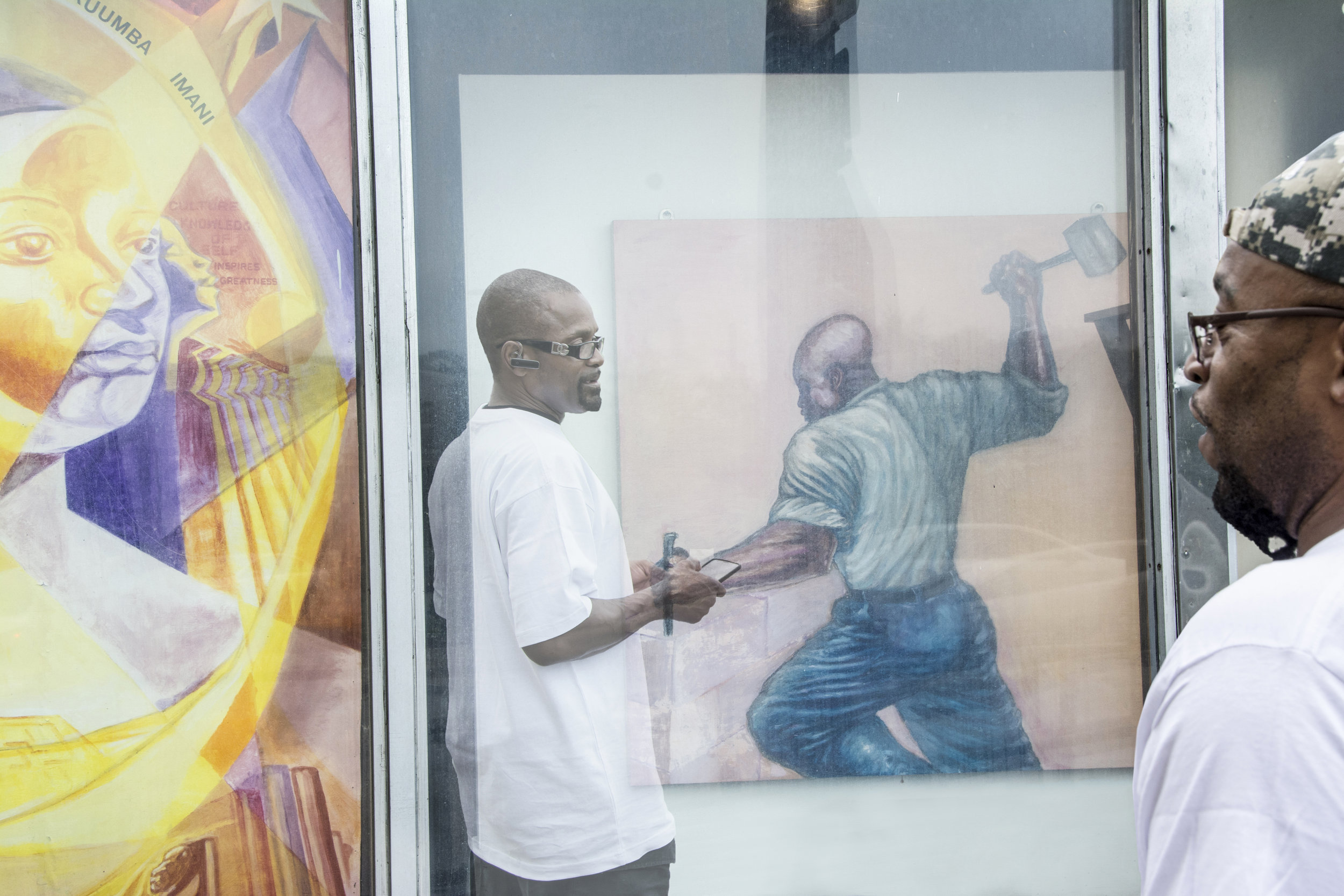 The two gentleman in this image worked at an audio store. I asked them to pose in front of an abandoned store window that showed the African American slave at work. There are four faces, each pair facing one another. In the creation of this image, I was hoping to symbolize the African American male experience.