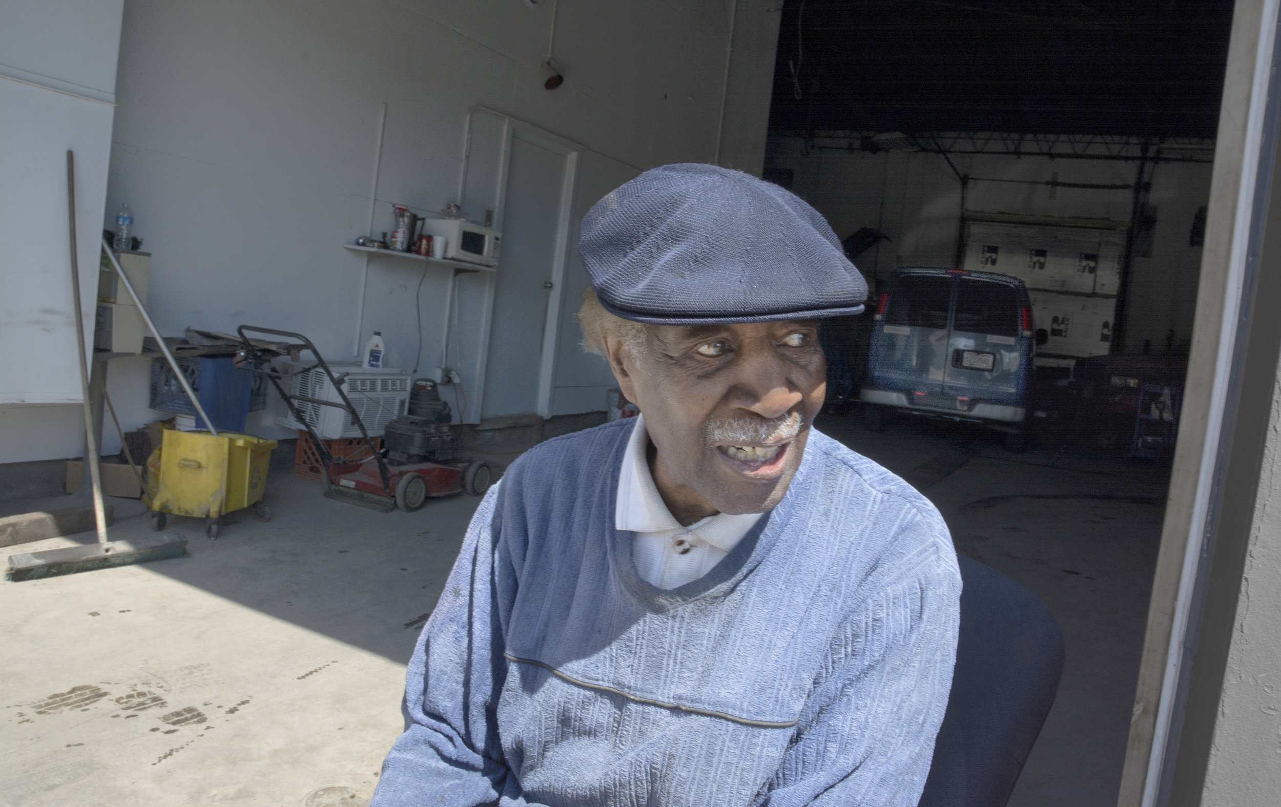 """Inside the Milwaukee ghetto, old Andy spends his days at Bernie's Auto Repair, talking shop, remembering the past. I told him I'd seen a lot of store-front churches, many closed. Andy nodded. """"I grew up in this neighborhood. Used to be a church on every corner, and a bar next to it."""""""