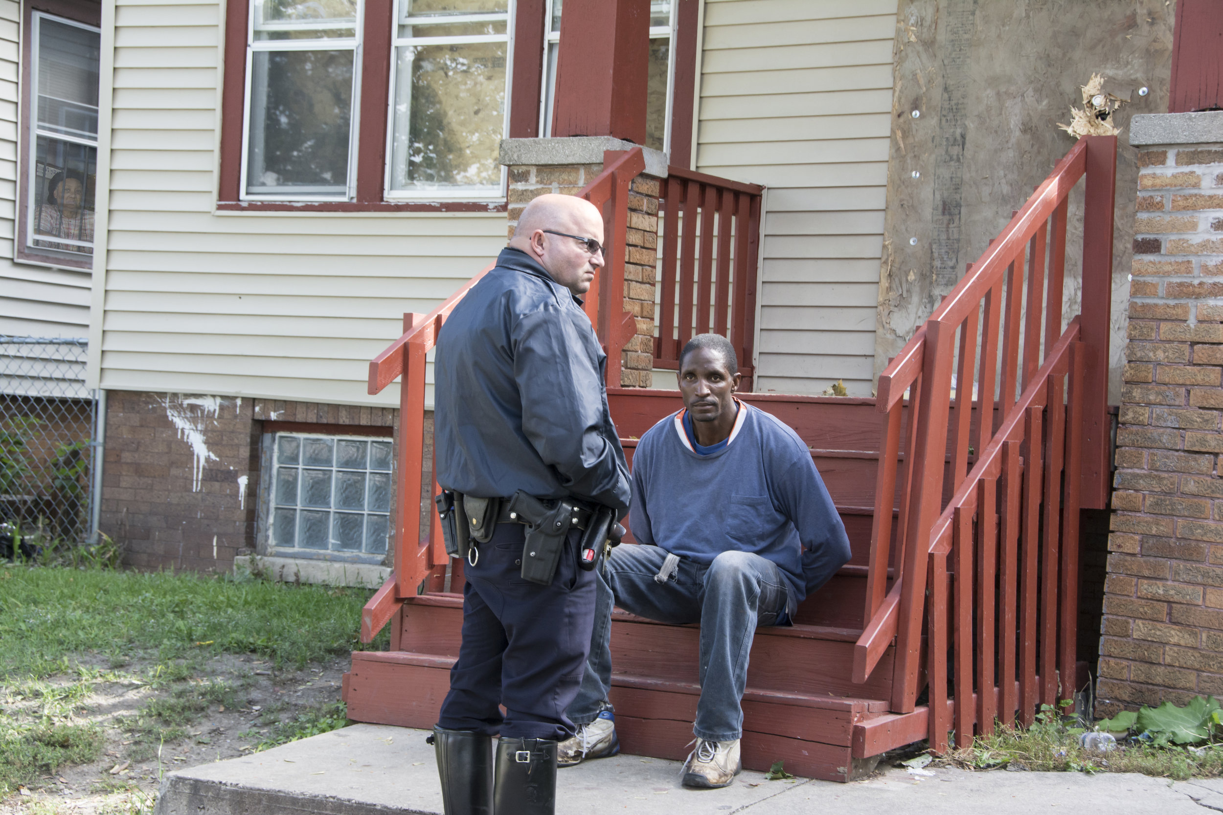 """The police call it the 1,000 yard stare, a criminal suspect's eyes glowing with hatred. This criminal sat in handcuffs on the stairs of the house he had just robbed and wrecked. The arresting officer told me, """"There are too many break-ins around here. The old people are scared."""""""