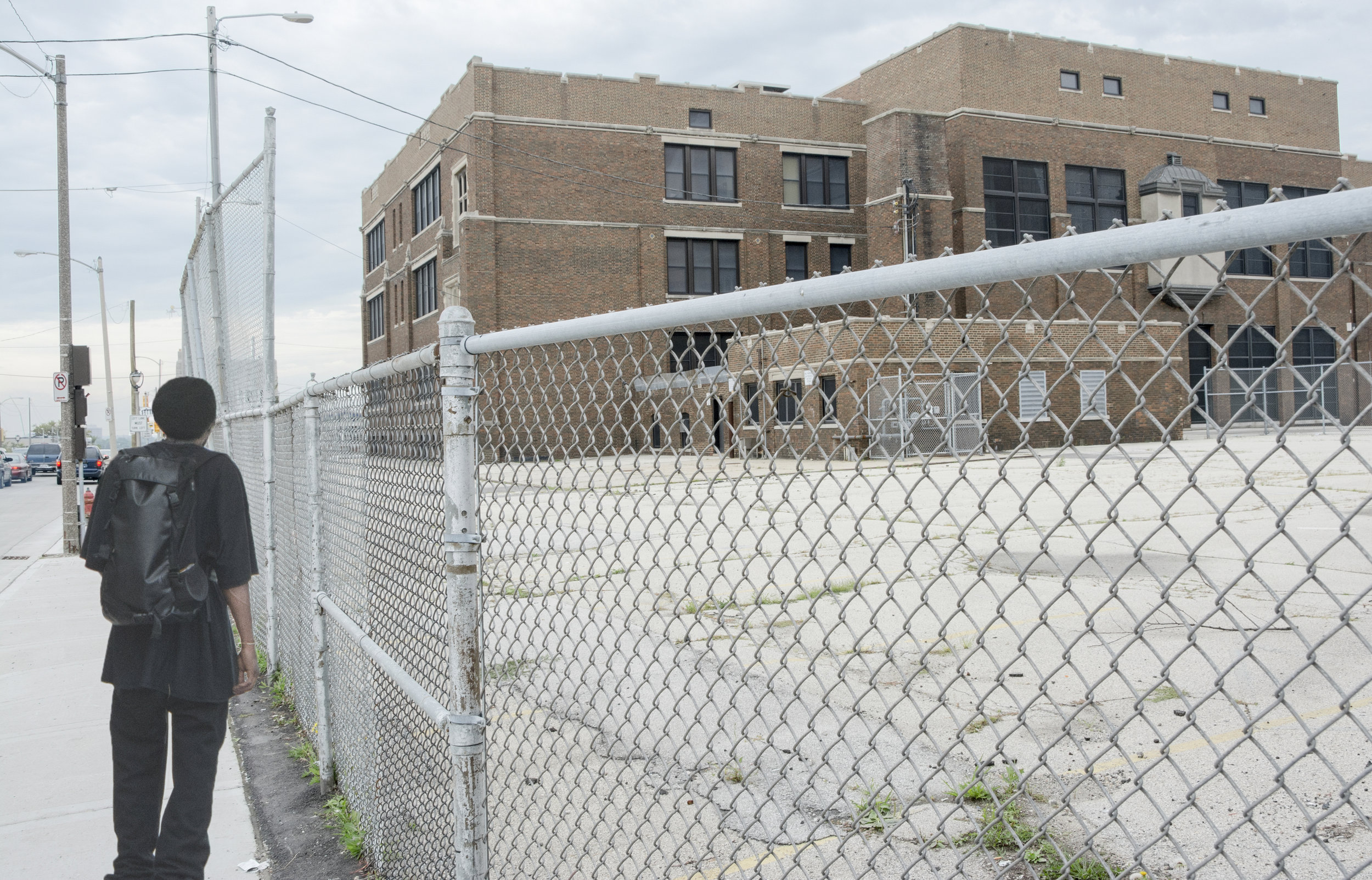 As of 2016, there were 13 closed public schools in Milwaukee, several located in the inner city, this one at 27th and Wisconsin. Around the corner were several multi-story public apartment buildings also closed.