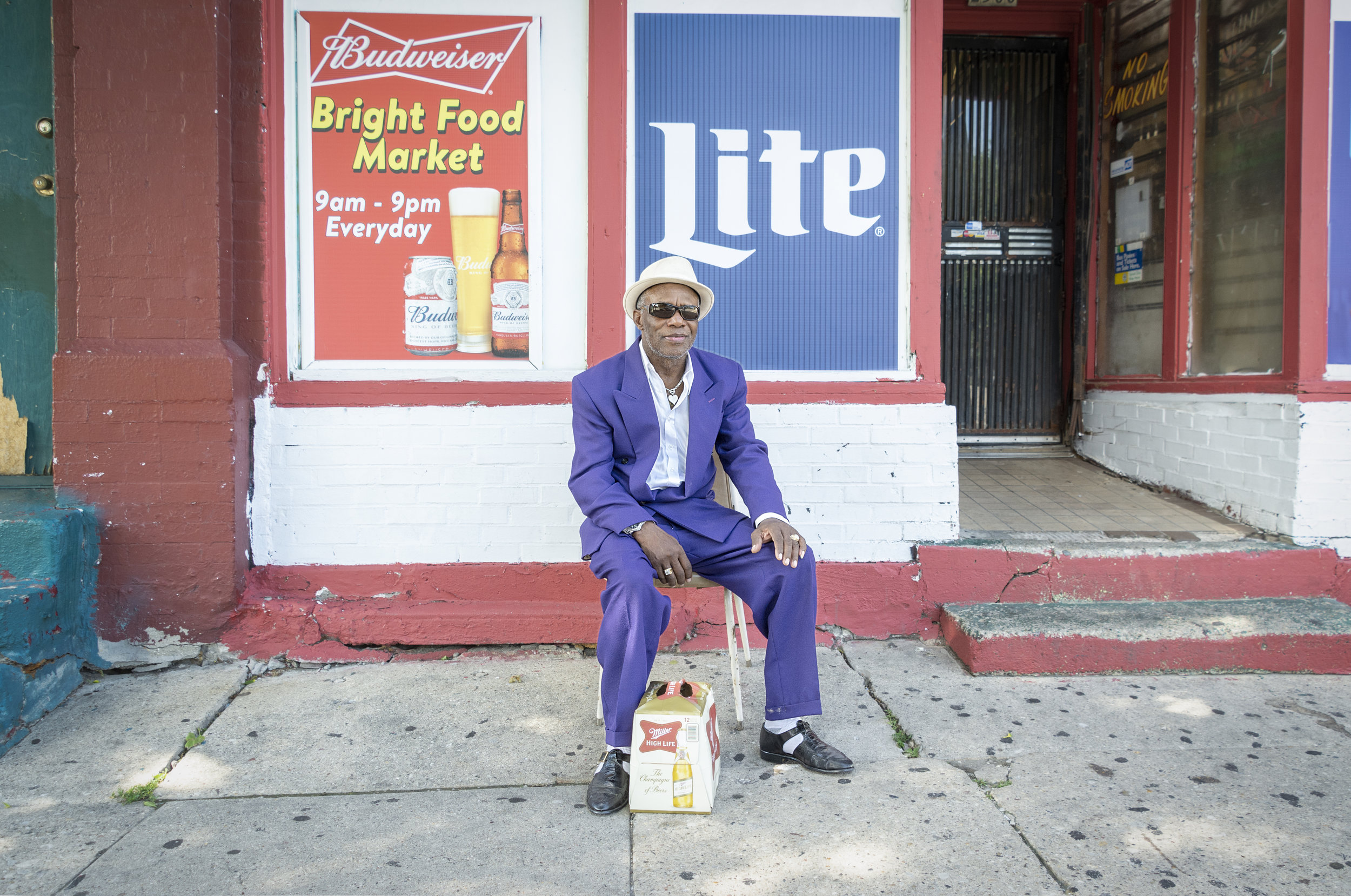 """I found Henry Finschis taking a break in front of a corner store. He said, """"I came up to Milwaukee from Mississippi by myself at 25. All these years since, I worked construction. I even laid the concrete for these here sidewalks.""""  I asked if he thought the neighborhood had changed. """"Hell, yes. Too many law-breakers now, reckless drivers, got no respect for others. They should be locked up.""""   I said, """"I've been walking these streets on and off for six years, talking to folks. Some resent me cause I'm white.""""  He said, """"Just keep doing what you are doing. We're all of color."""""""