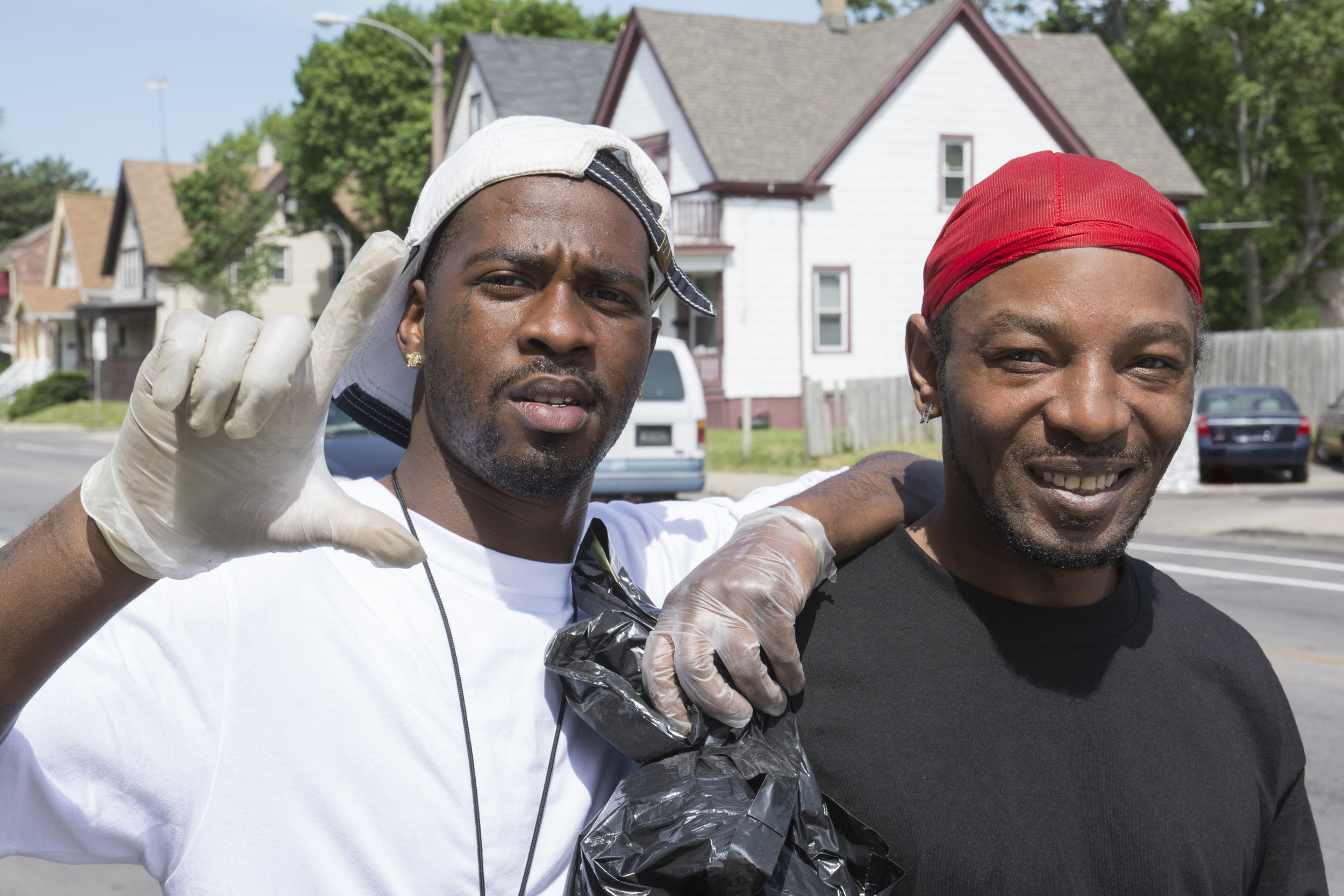 """Cheddar and Ronnie are volunteers. They spend time off work picking up discarded waste in their neighborhood. """"Somebody's gotta do it,"""" Ronnie told me. """"The streets and alleys can get messy."""""""