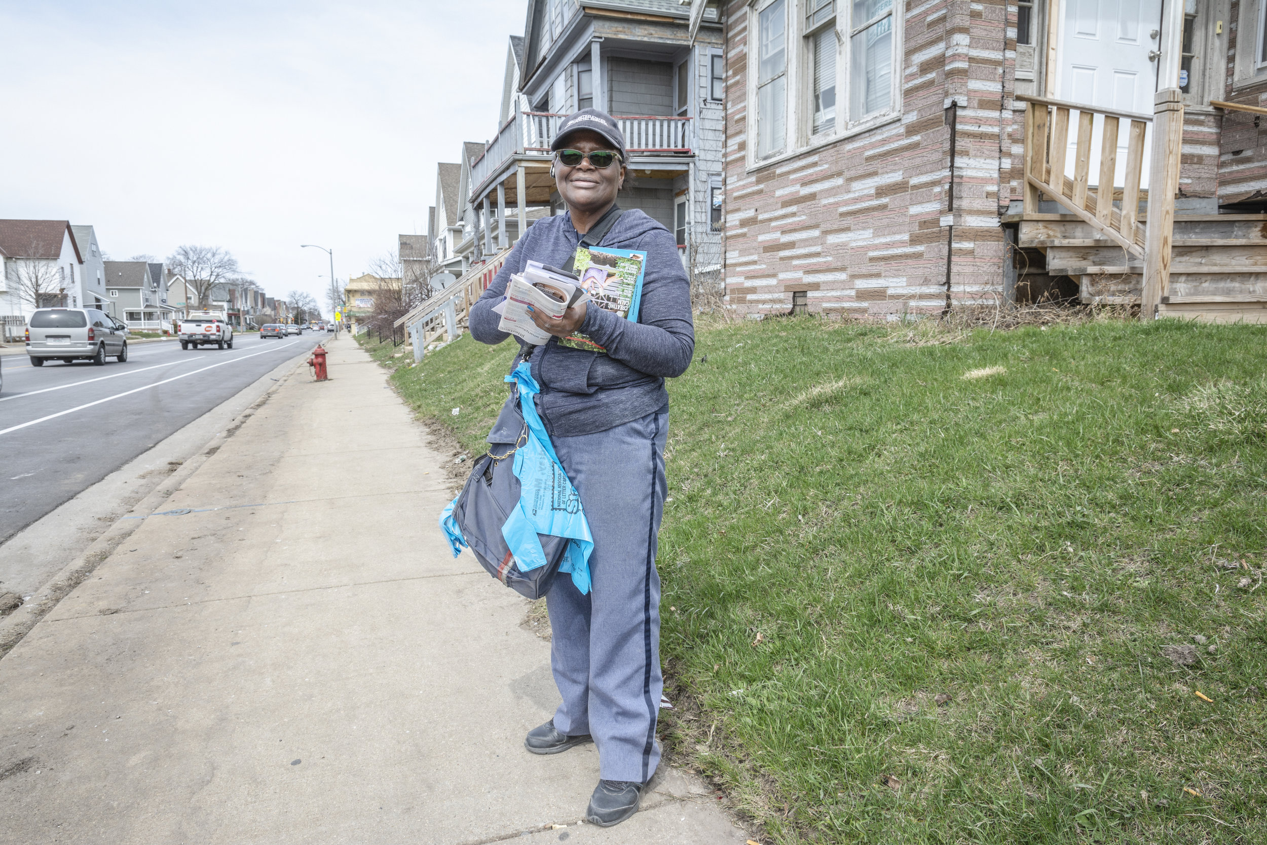 Cheryl has been an inner city postal carrier for five years. I asked her how much territory she covered. She got out her smartphone and showed me. The device counts her steps. She averages around 27,000 steps a day. I figured that to be about one foot per step. That means she walks over five miles a day along cracked sidewalks, potholed streets and warped porch steps, carrying that mail pouch.