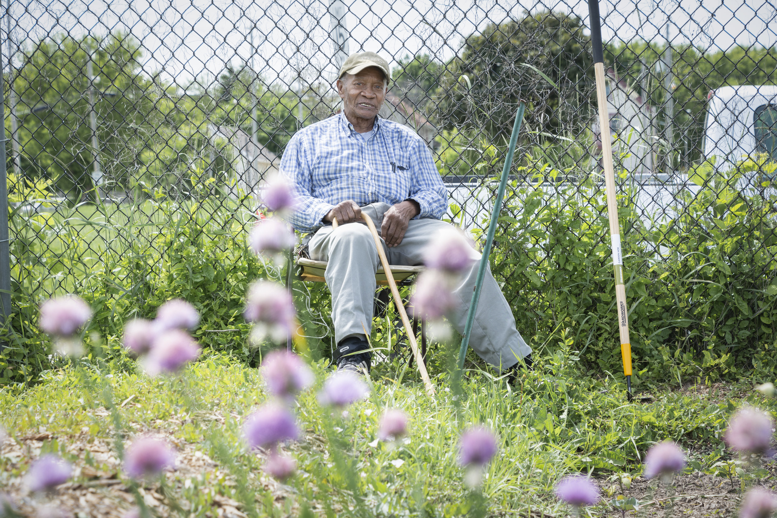 I met Edgar Jackson in a community garden surrounded by buildings and blacktop. He said he came to Milwaukee alone from Louisiana in 1971, that he worked at a tannery until he retired. At 77, he now uses a cane to get around, but he carefully tends his garden plot or relaxes in his chair and gazes at his flowers.