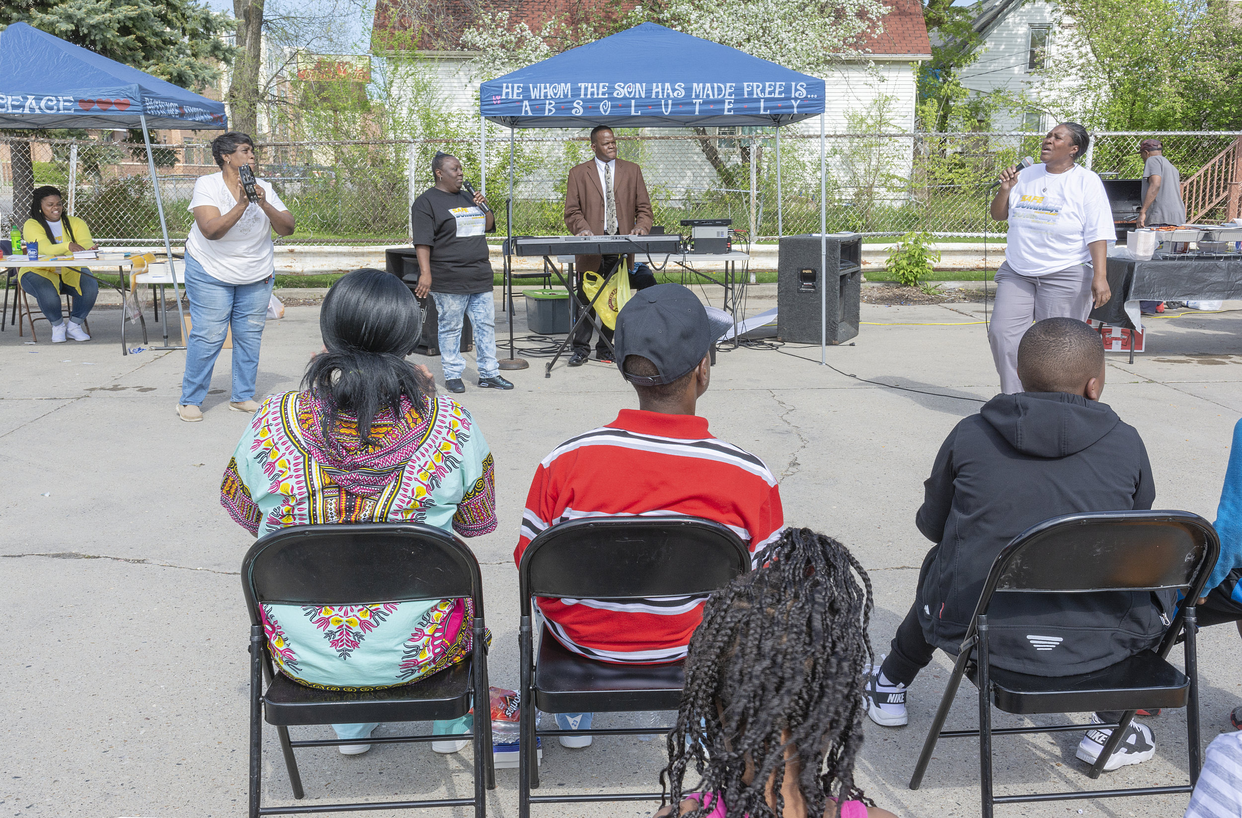 """In the heart of the inner city, I found a small church converted from an old liquor store. The sign read Faith Harvest Outreach Ministries. The service was being held in the parking lot. After a while, the singer turned to sermonizing. She shouted, """"I am no longer an adulterous, I have given my heart to Jesus."""" The listeners yelled, """"Hallelujah, Sister!""""  Later, I told Pastor Ken I found the performance inspiring. He gave me a brochure, a list of Peace Covenants. Two covenants stood out for me ….. I WILL PUT NEIGHBOR BACK IN THE HOOD and WHEREVER THERE IS VIOLENCE I WILL MEDIATE PEACE."""