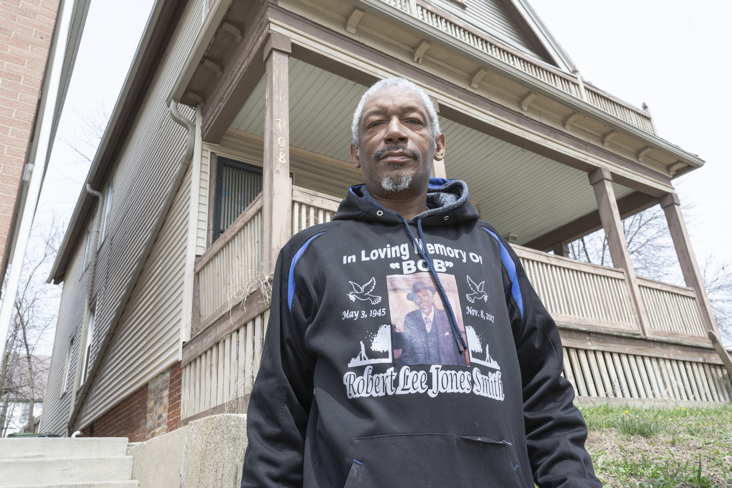 Reggie Jones Smith III told me that his dad and grandpa grew up in Memphis and they were bootleggers who eventually migrated to Milwaukee to continue in bootlegging. Reggie worked at Pabst Brewing until he was laid off years ago. Here in front of his home, Reggie wears a sweatshirt to pay tribute to his dad, Robert Lee.
