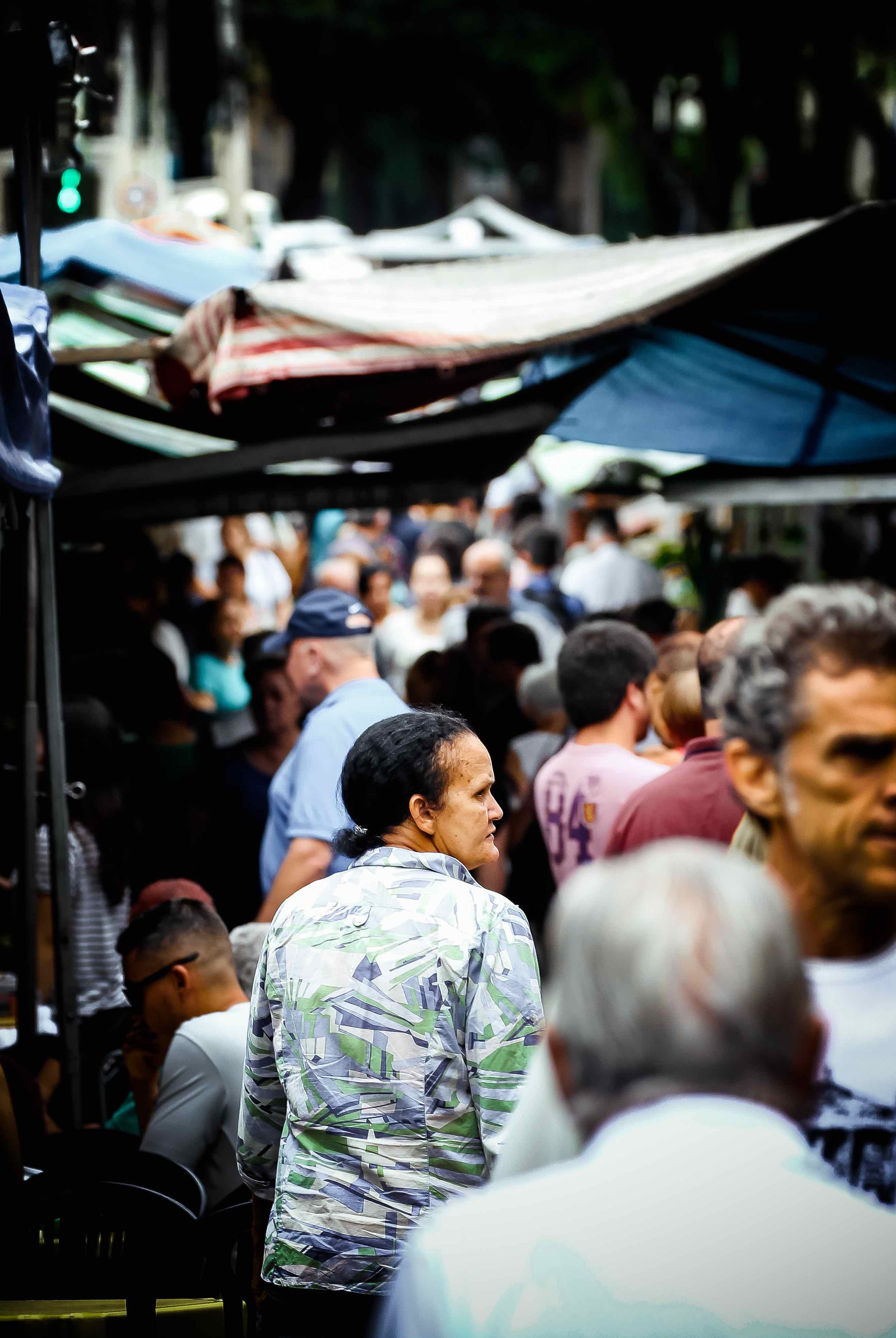 Woman looks on at the local  Feira (Farmer's Market).
