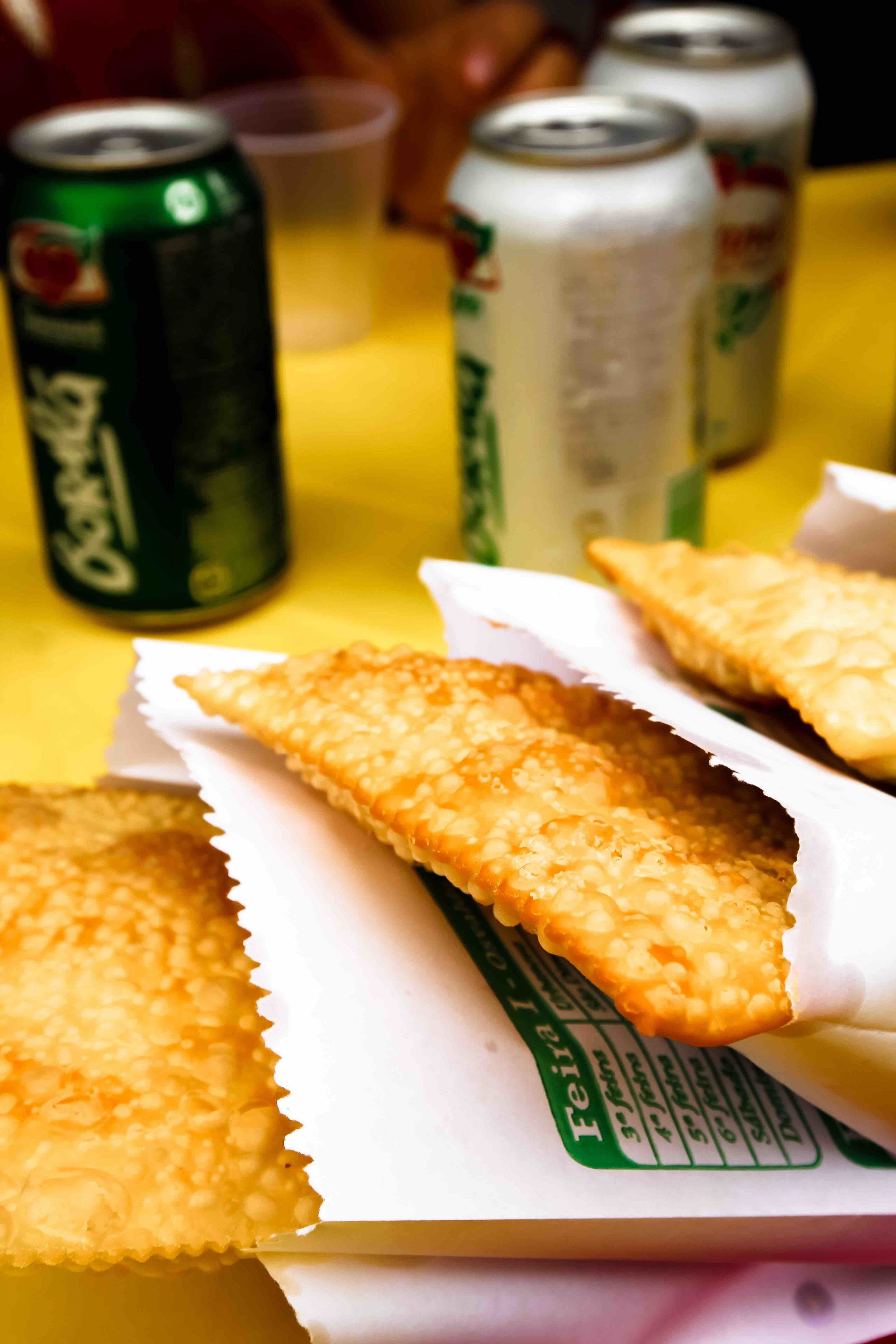 Locally-made  Pastel , a fried pastry filled with meat, cheese, or, sometimes, nothing.