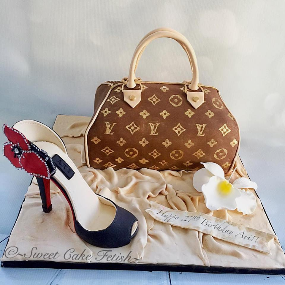 This week we had the pleasure to create this stunning purse and shoe cake for a special young lady turning 27! She truly was a pleasure to work with and loved her LV Purse cake and shoe.